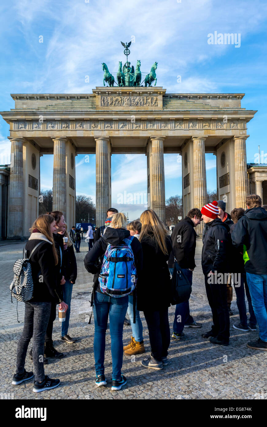 Berlin, Germany, Group Young Teen Tourists, on Street, visting Brandenburg Gate, Port Monument, Mitte District Stock Photo