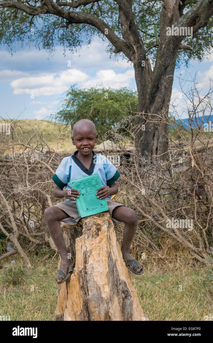 MASAI MARA, KENYA - September, 23: Masai boy on September, 23, 2008 in Masai Mara National Park, Kenya Stock Photo