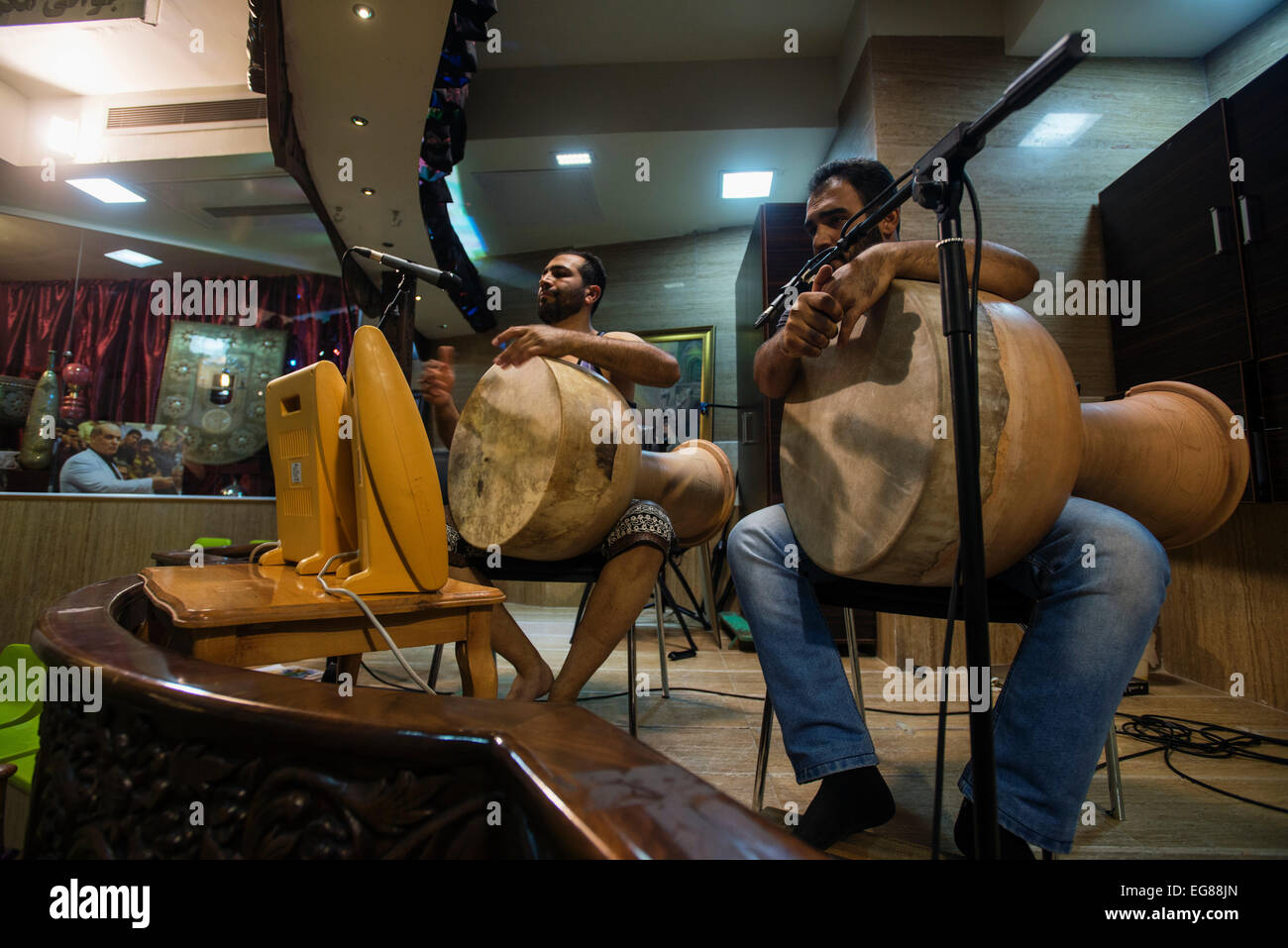 Musicians sings Shahnameh and drum during training in zurkhaneh to help pahlevans to keep rhythm and bravery, Esfahan, - Stock Image