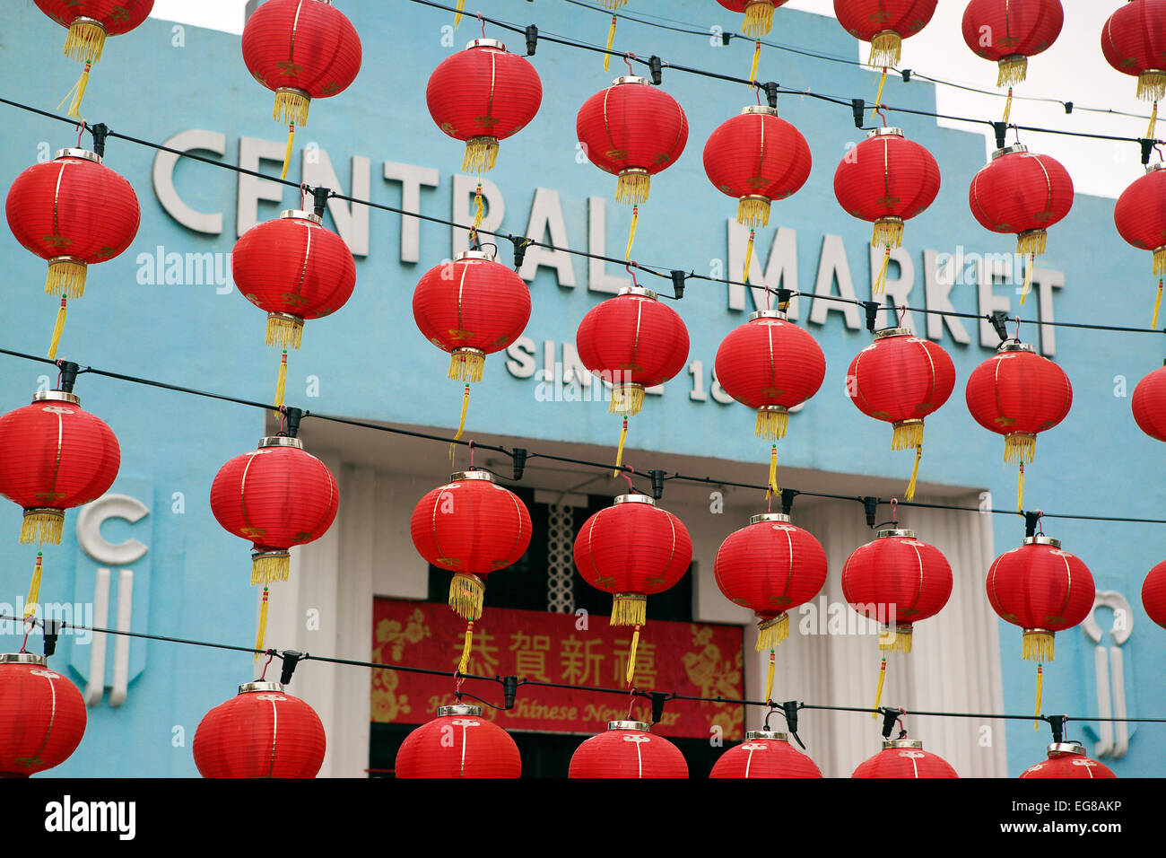 Red lanterns hanging outside the Central Market in Chinatown for Chinese New Year celebrations Stock Photo