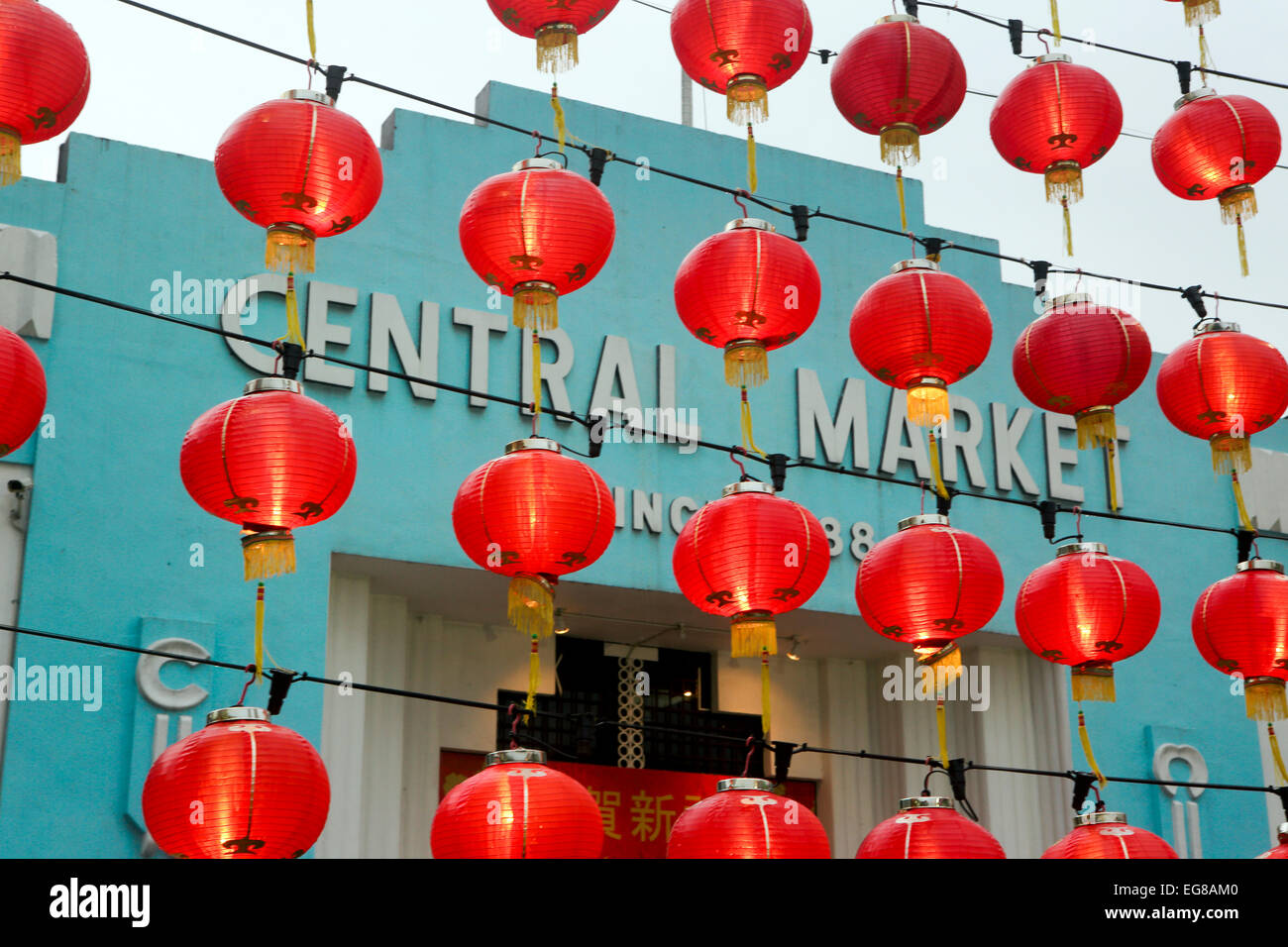 Red lanterns hanging outside the Central Market in Chinatown for Chinese New Year celebrations - Stock Image