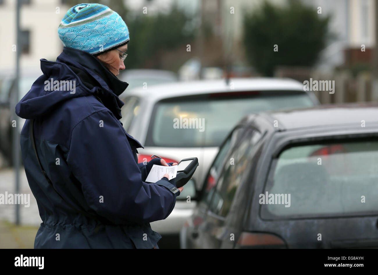 Rostock, Germany. 30th Jan, 2015. A raffic policewoman issues a parking ticket in Rostock, Germany, 30 January 2015. - Stock Image