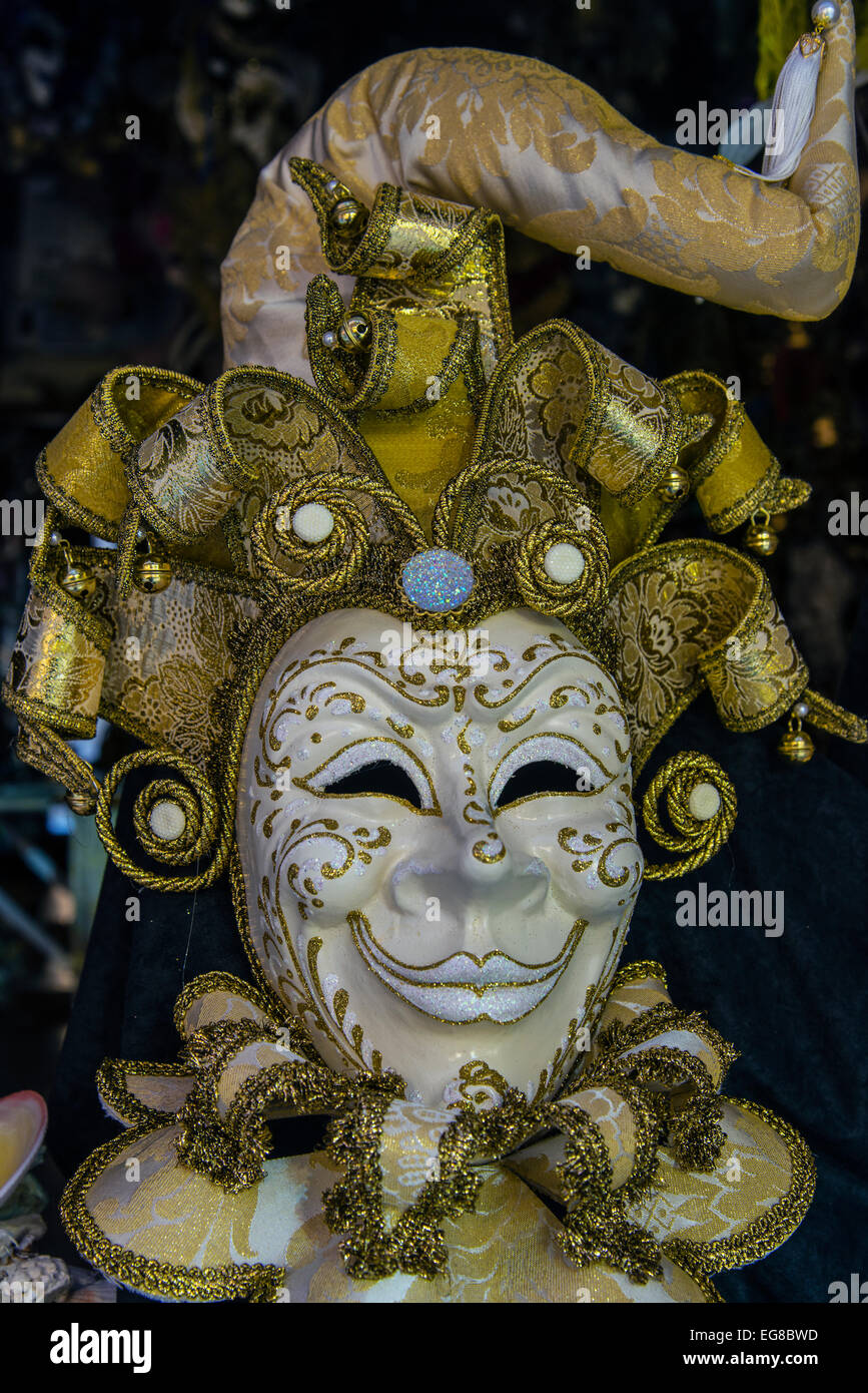 Traditional Venetian carnival mask in a shop window, Venice, Veneto, Italy - Stock Image