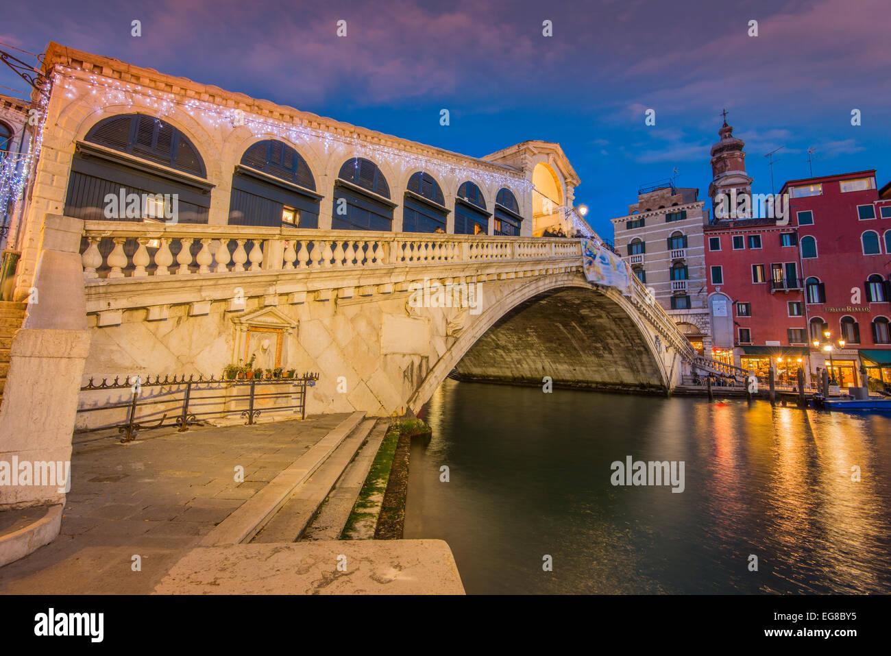 Rialto Bridge at dusk, Venice, Veneto, Italy - Stock Image