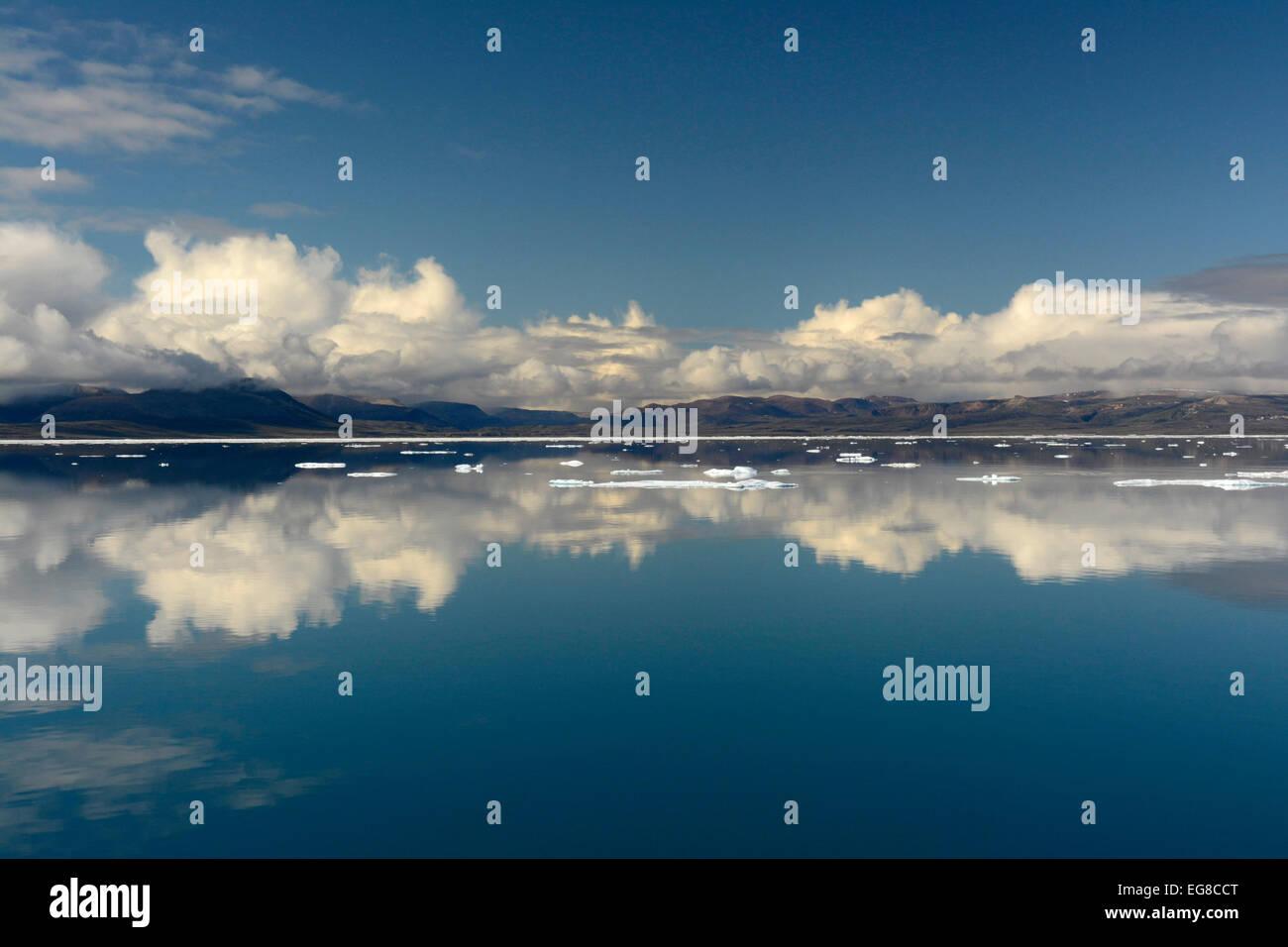 Baffin Island, Nunavut, Canada, showing coastline in calm sea, August Stock Photo