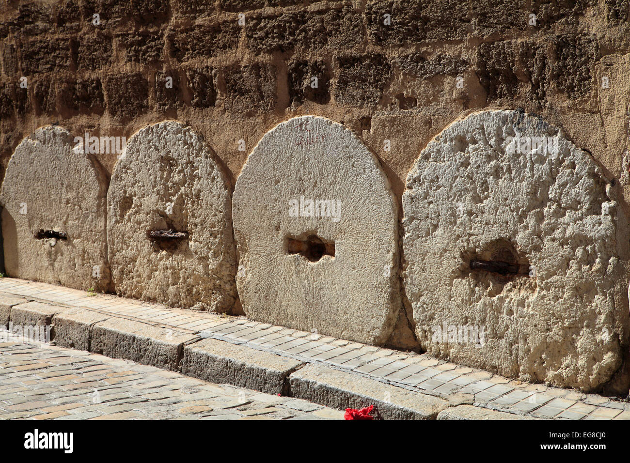 Spain, Andalusia, Seville, millwheels protecting wall, street scene, - Stock Image