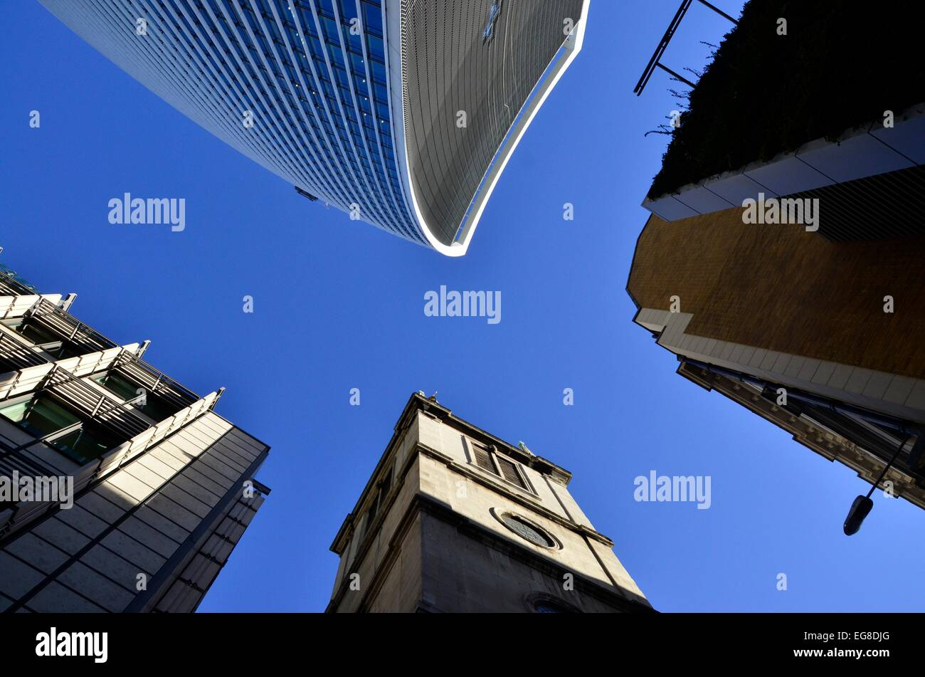 Looking Up on Fenchurch Street, City of London - featuring Wren's St Margaret Pattens Church and the Walkie Talkie Building Stock Photo