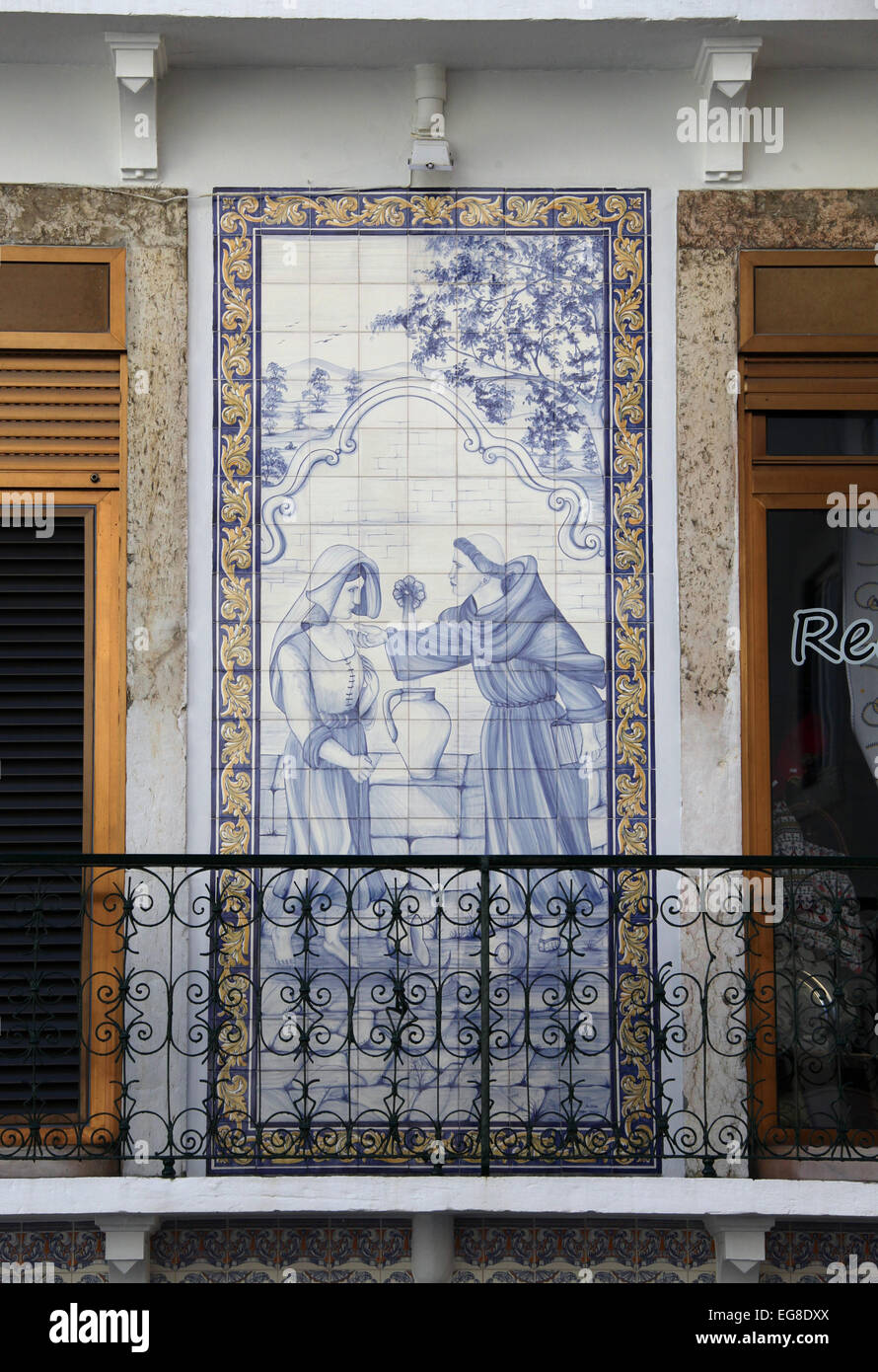 Azulejos on an Alfama Cafe building in Lisbon - Stock Image
