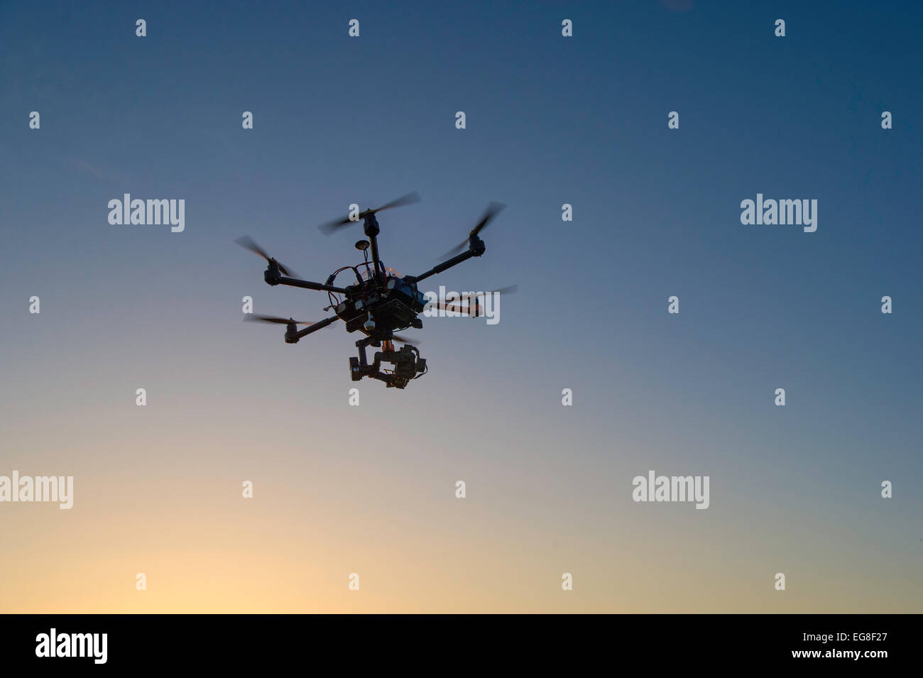 Drone flying and take off with operator - Stock Image