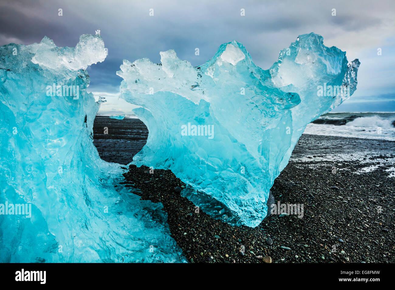 Blue Iceberg on Jokulsarlon black beach Jokulsarlon Iceland - Stock Image