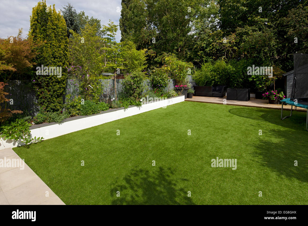 Artifical plastic fake lawn in English contemporary garden,Oxfordshire,England - Stock Image
