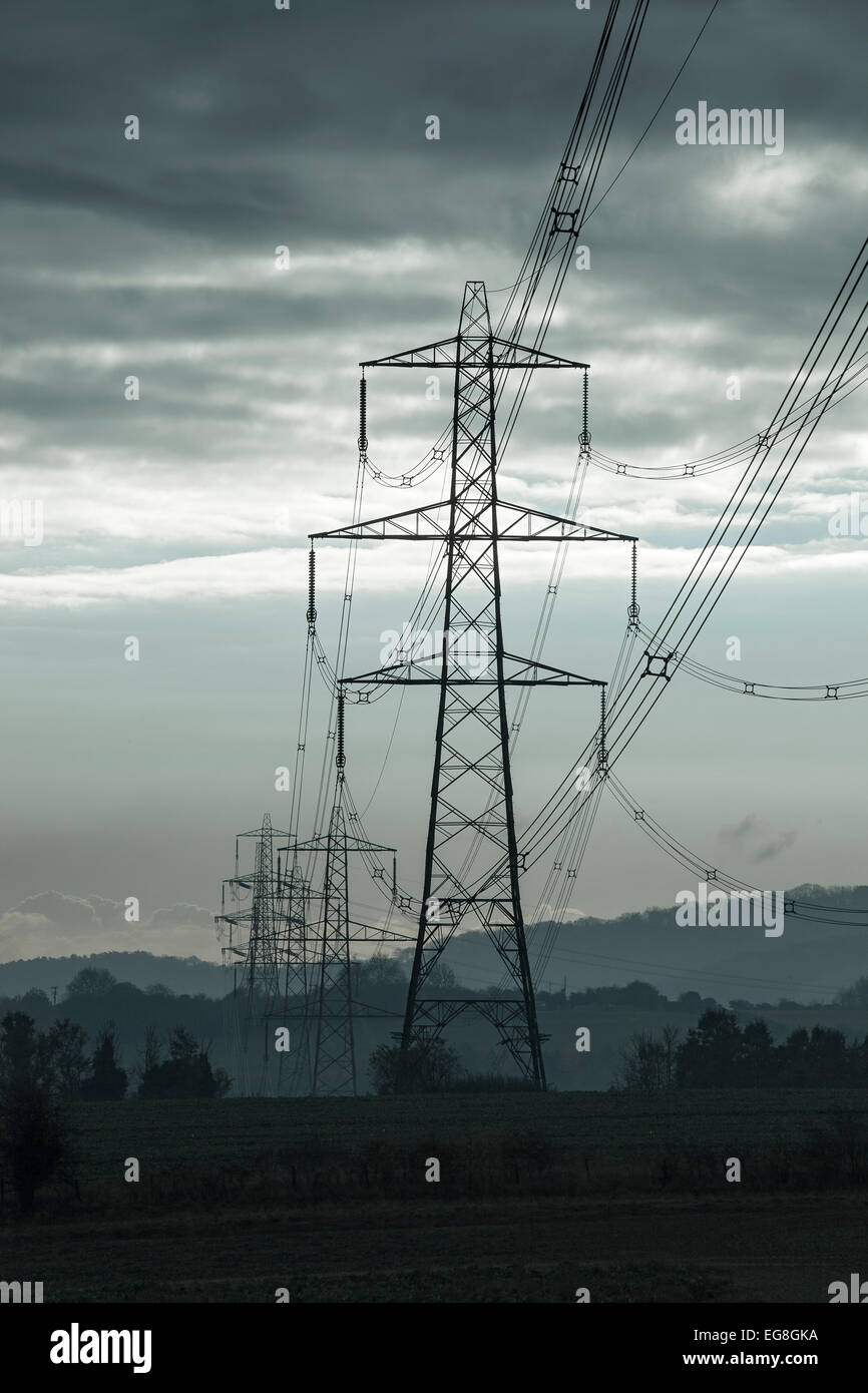 Electric pylons leading into a stormy sky,Oxfordshire,England - Stock Image
