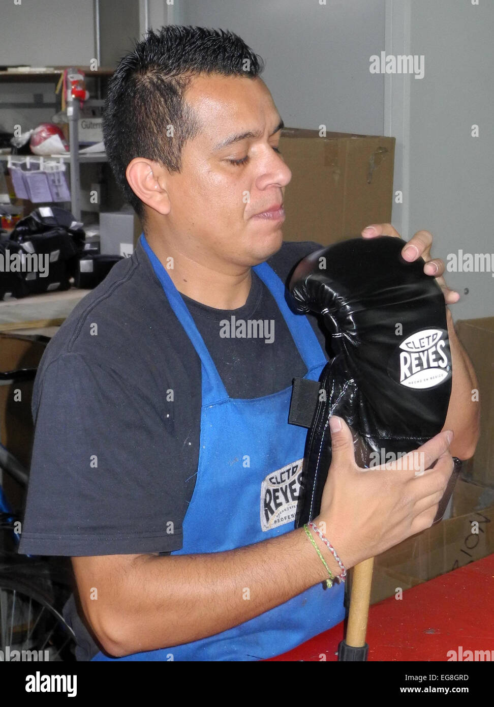 A staff member of manufacturer of boxing gloves Cleto Reyes