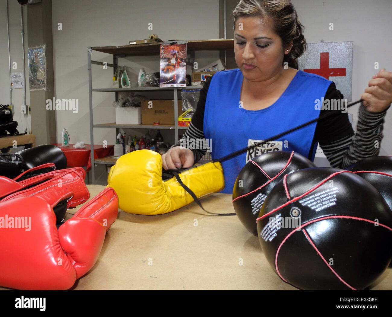 A staff member of manufacturer of boxing gloves Cleto Reyes works on a professional boxing glove on the company's - Stock Image