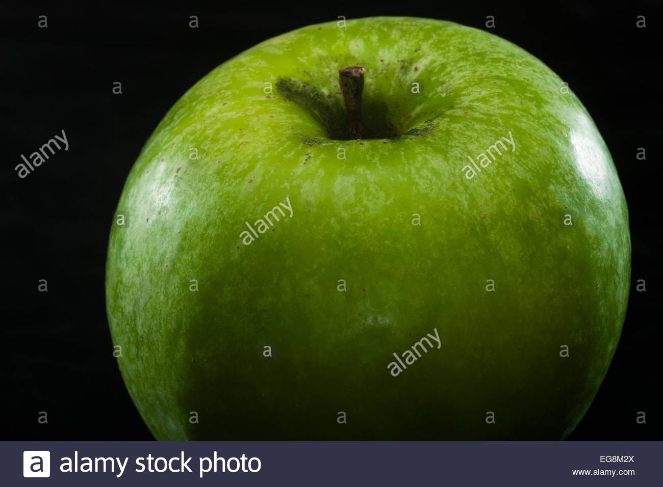 green apple on dark background - Stock Image