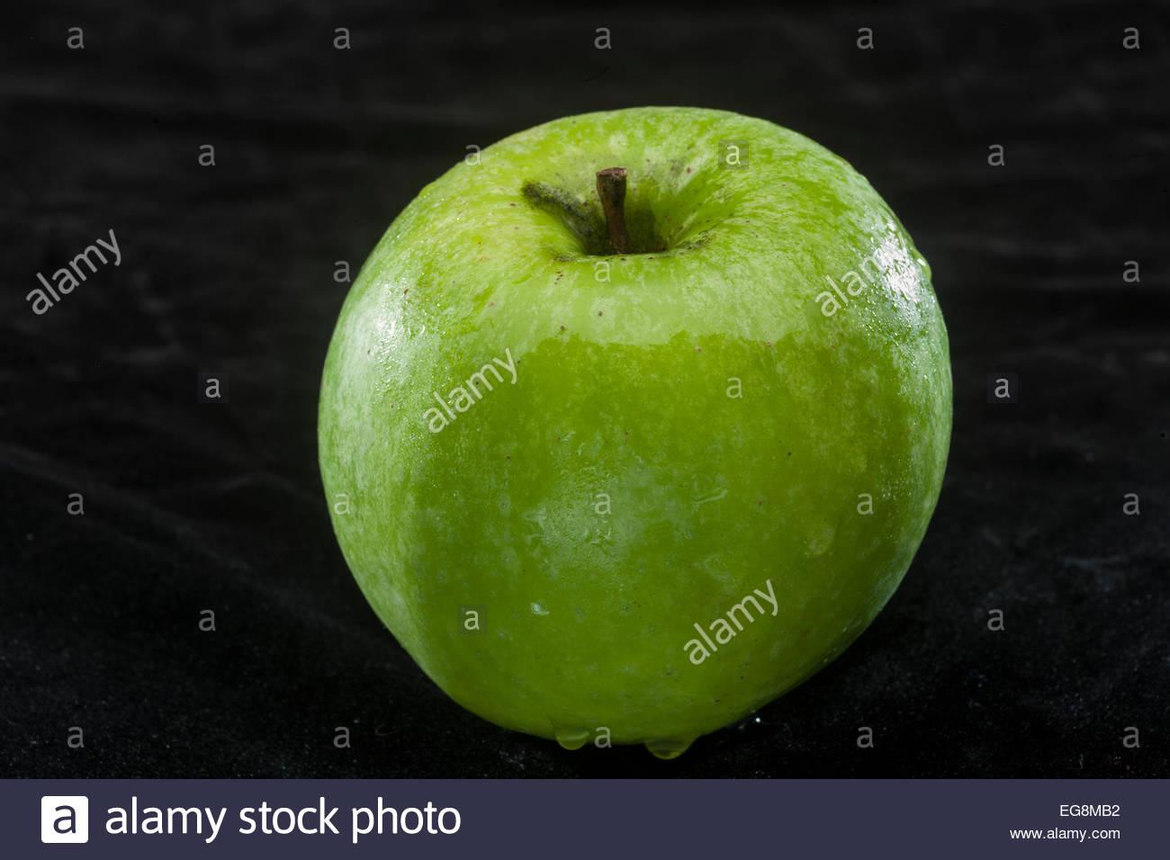 green apple on black background - Stock Image