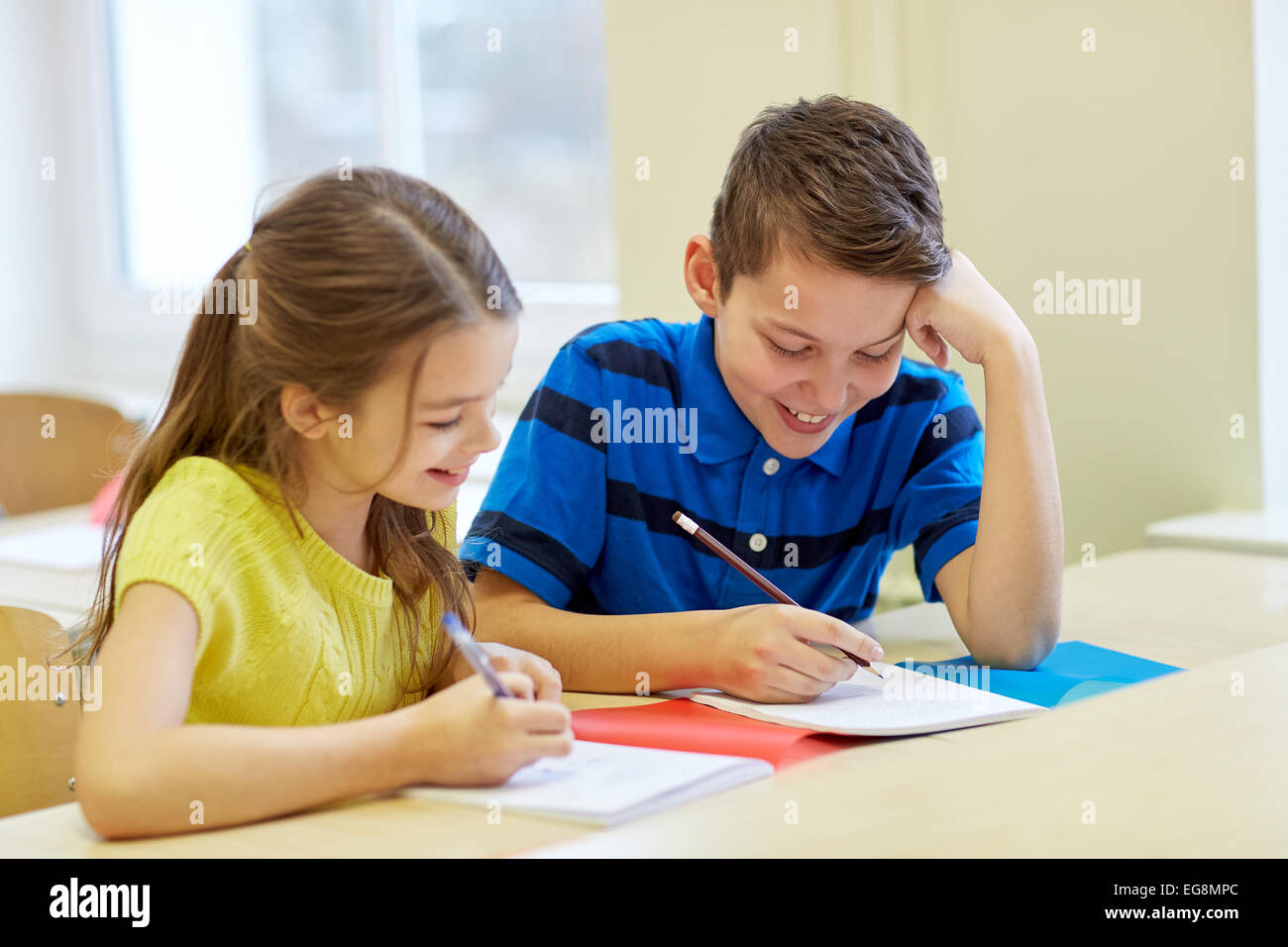 group of school kids writing test in classroom stock photo: 78867892