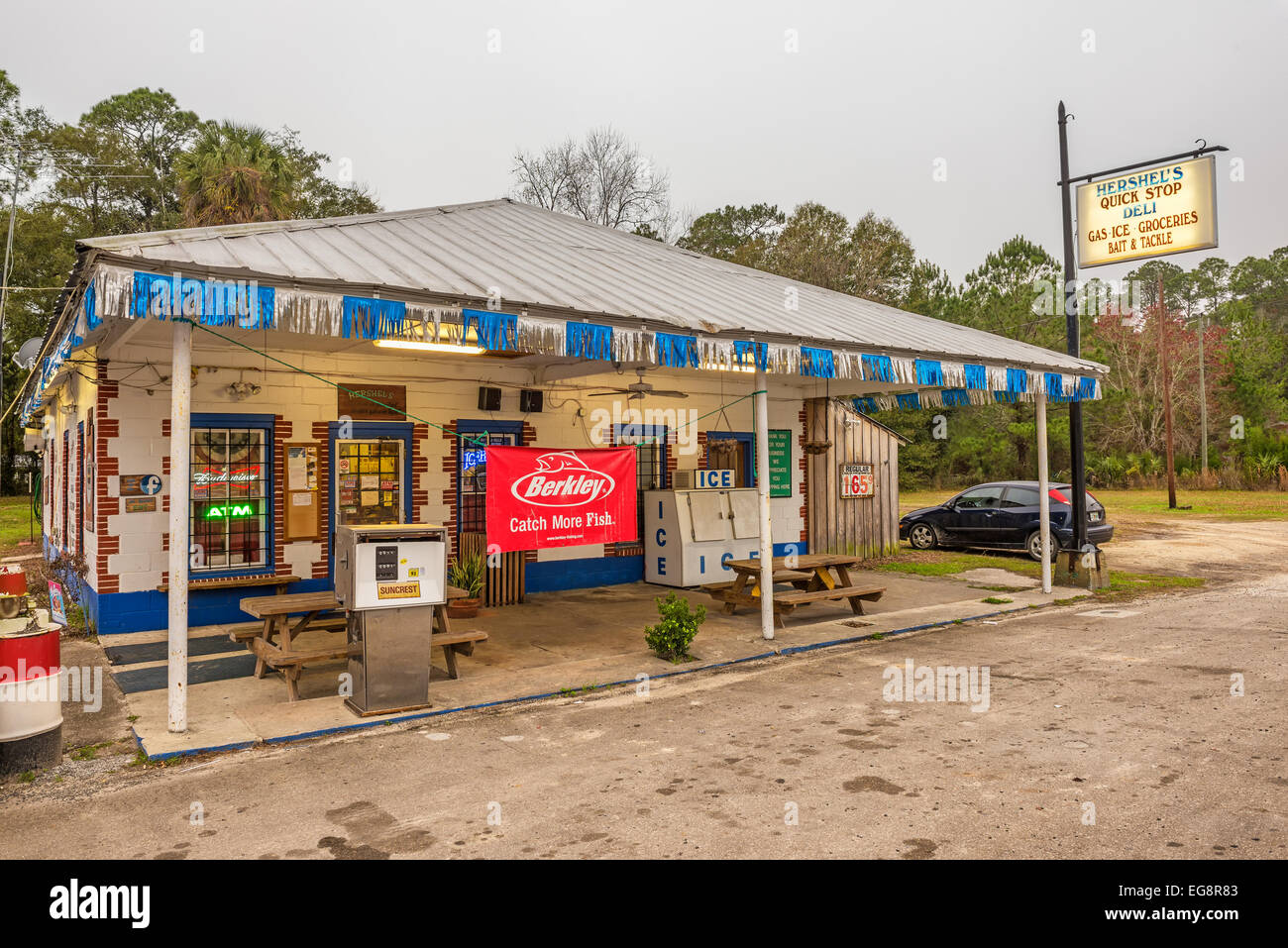 Vintage gas pump and a general store on US Highway 19, near Cedar Key, Florida - Stock Image