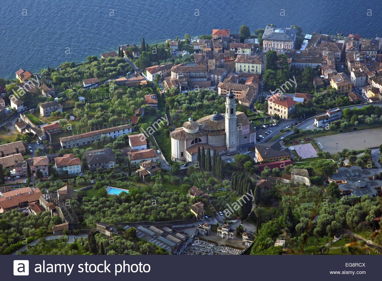 Aerial view over the village Gargnano and the San Martino church on the western shore of Lake Garda, Brescia, Lombardy, Stock Photo