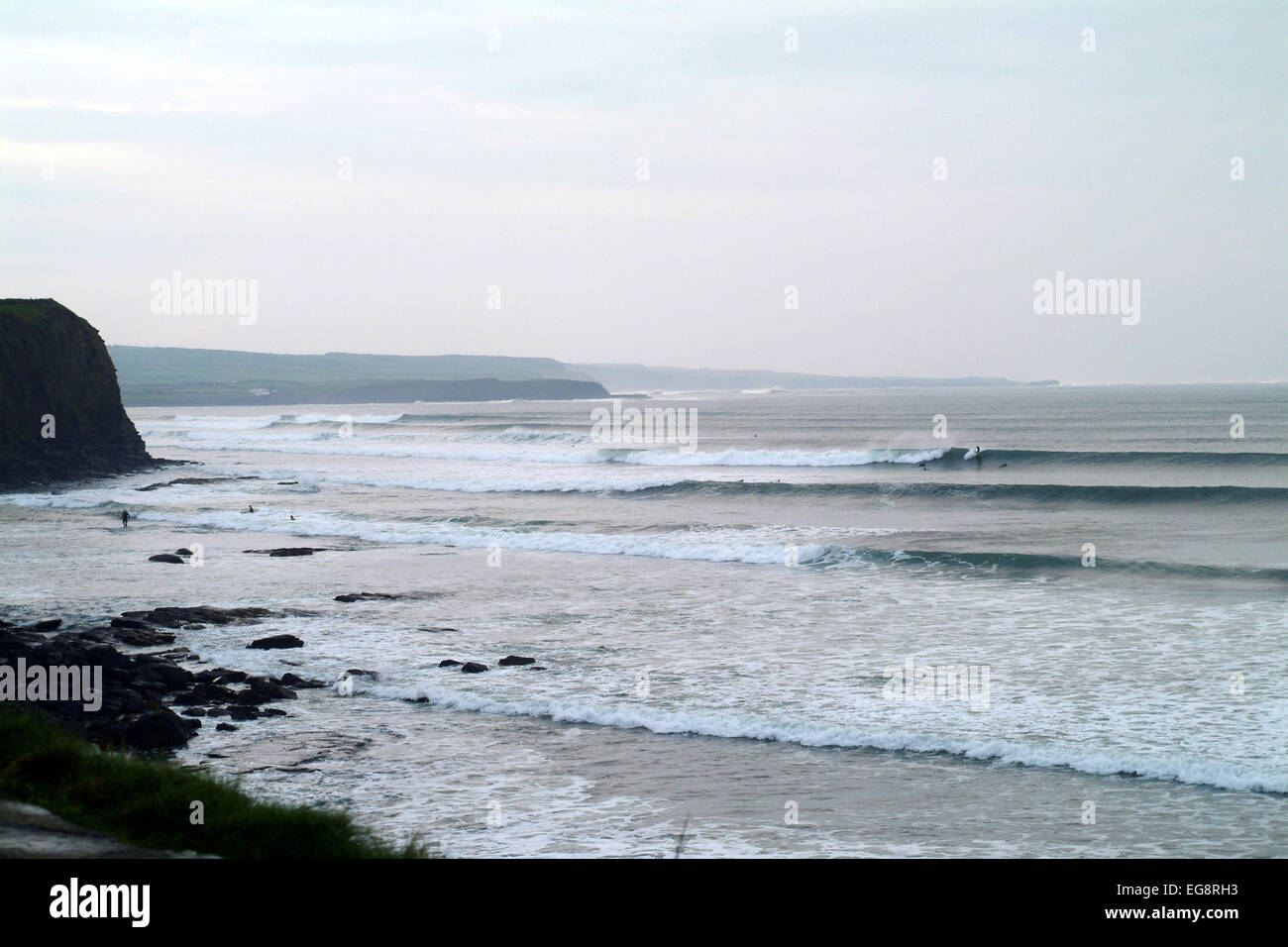 long perfect waves at Lahinch, Ireland peel across the  beach on Ireland's unspoilt west coast. - Stock Image