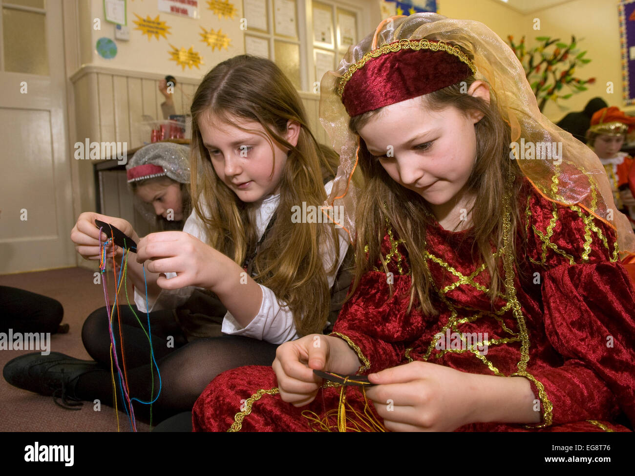 Pupils learning braiding at school during a Tudor Day, Surrey, UK. - Stock Image