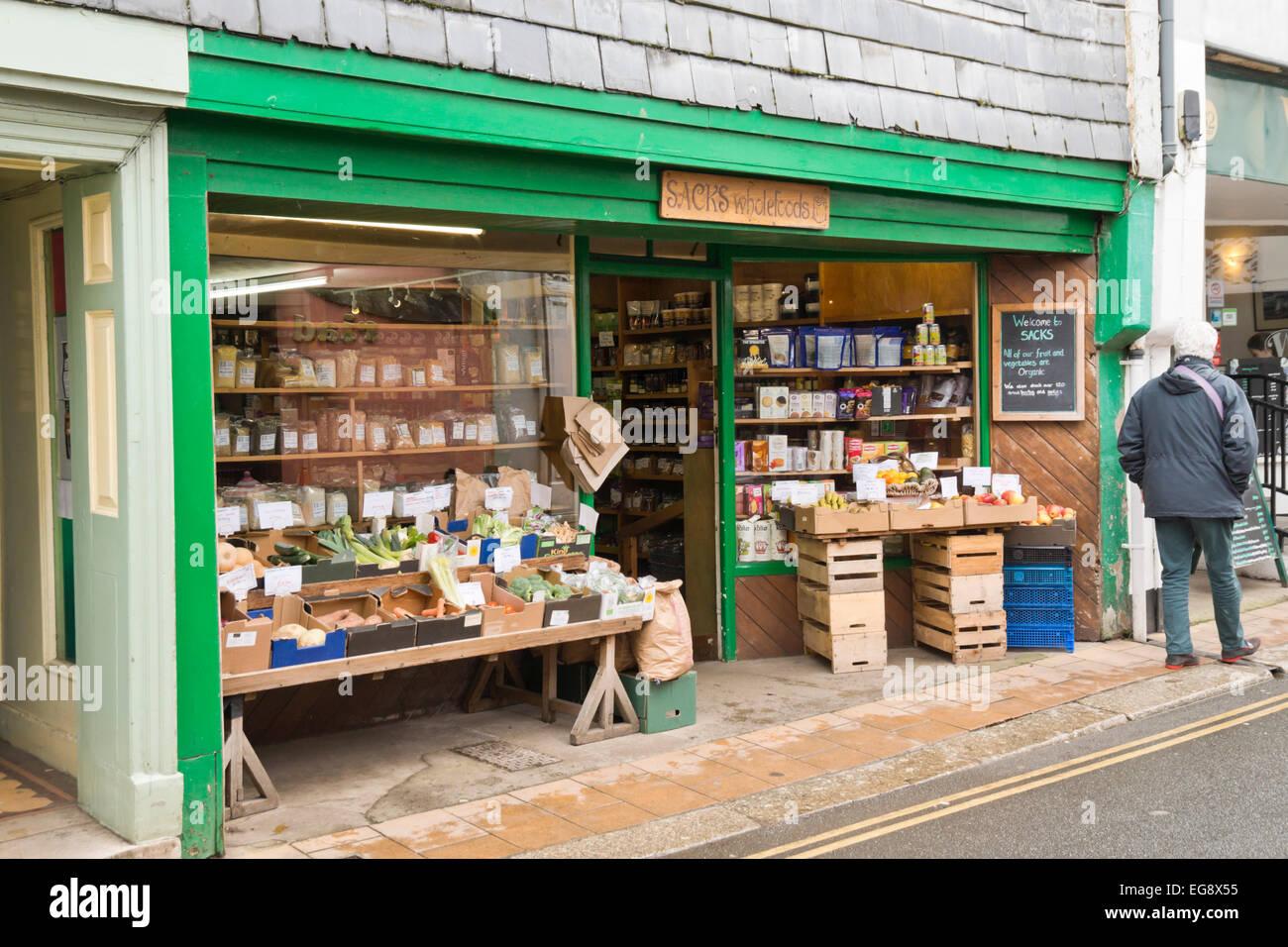 Totnes a market town in Devon England UK. Part of the south Hams district. Sacks wholefoods shop - Stock Image