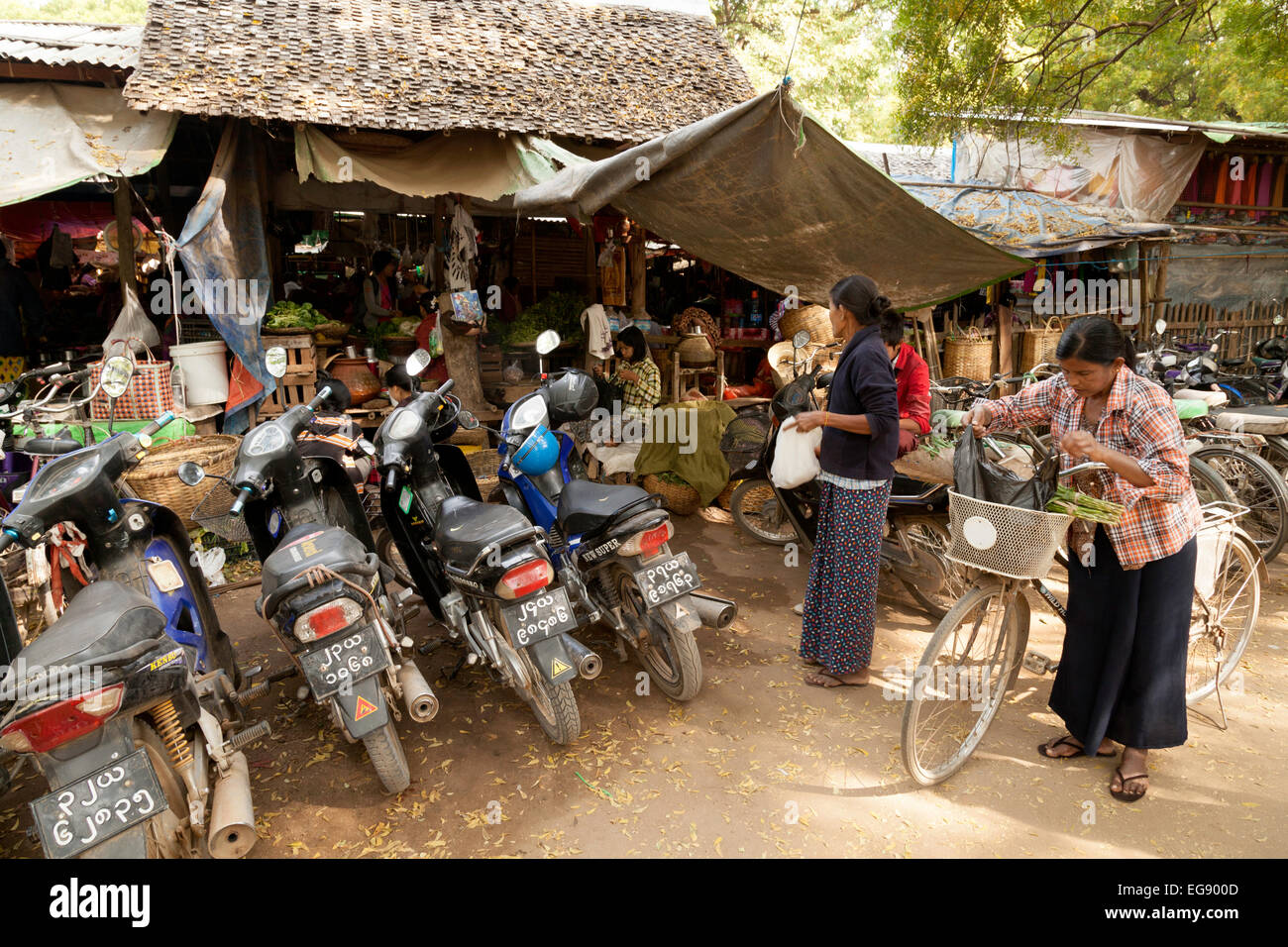 motorcycles and bicycles outside a village market, Bagan, Myanmar ( Burma ), Asia - Stock Image