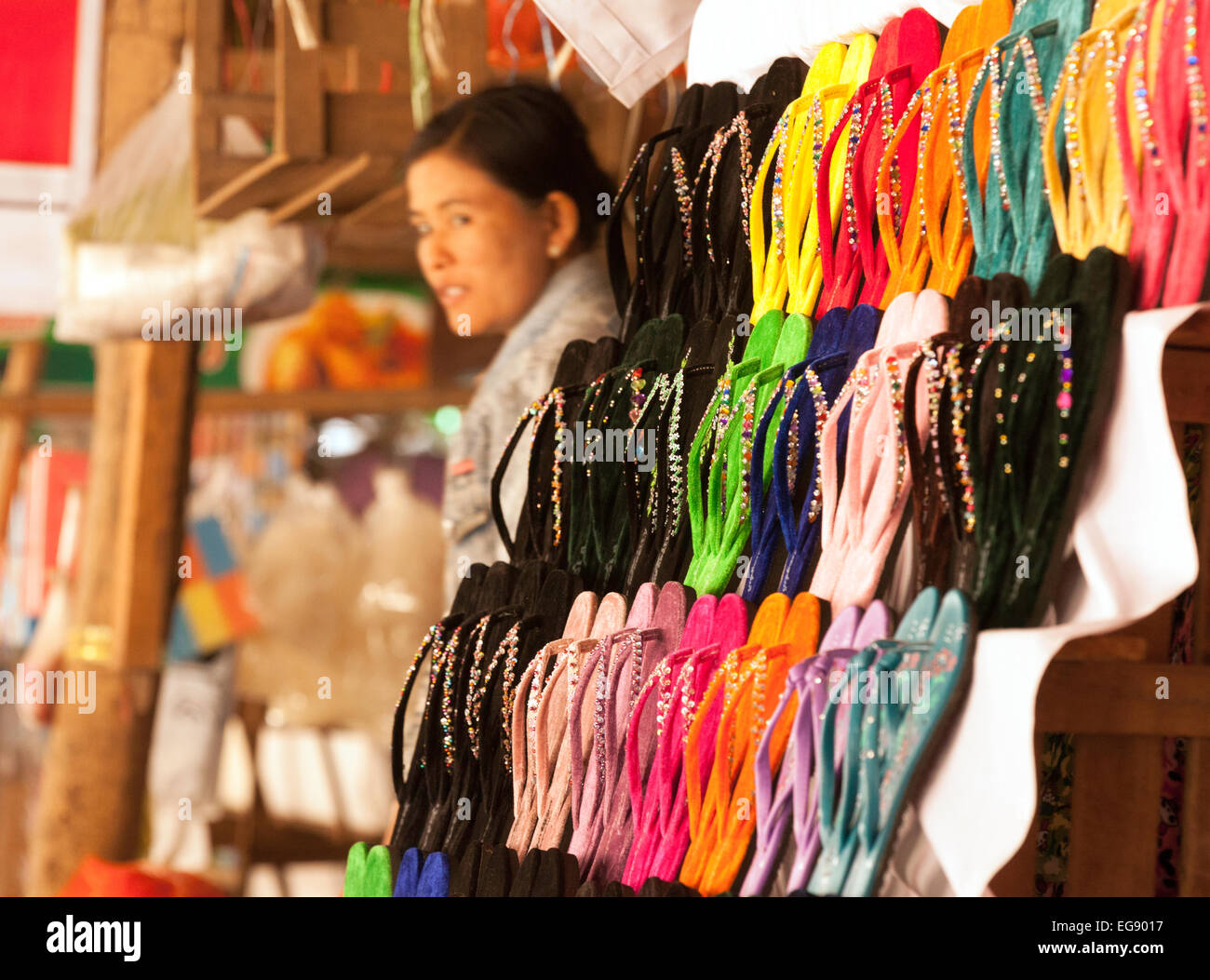 Burmese woman selling sandals and shoes, Mani Sithu Market in Nyaung-U village, Bagan, Myanmar ( Burma ), Asia - Stock Image