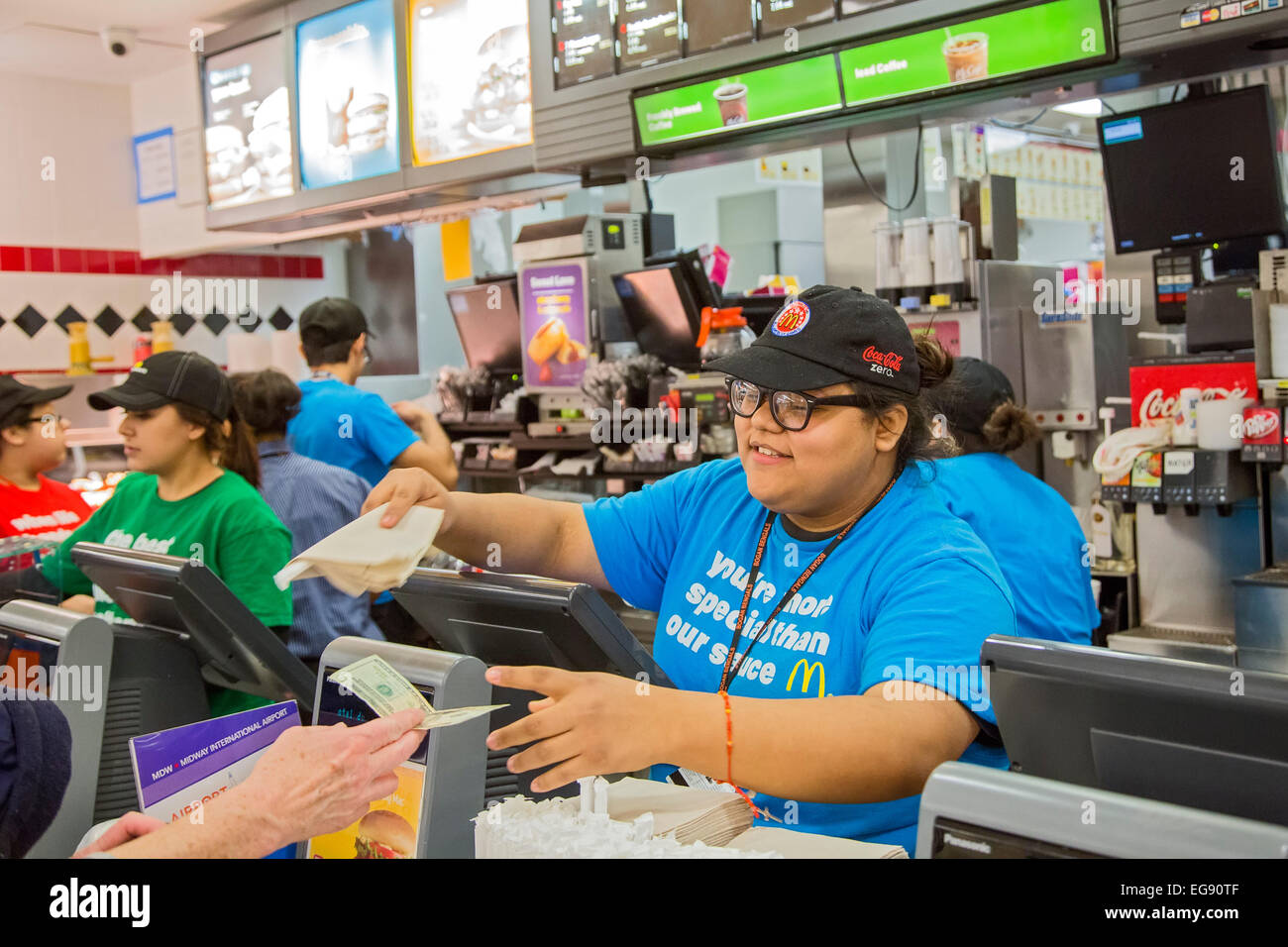 Chicago Illinois A Young Woman Waits On A Customer At A
