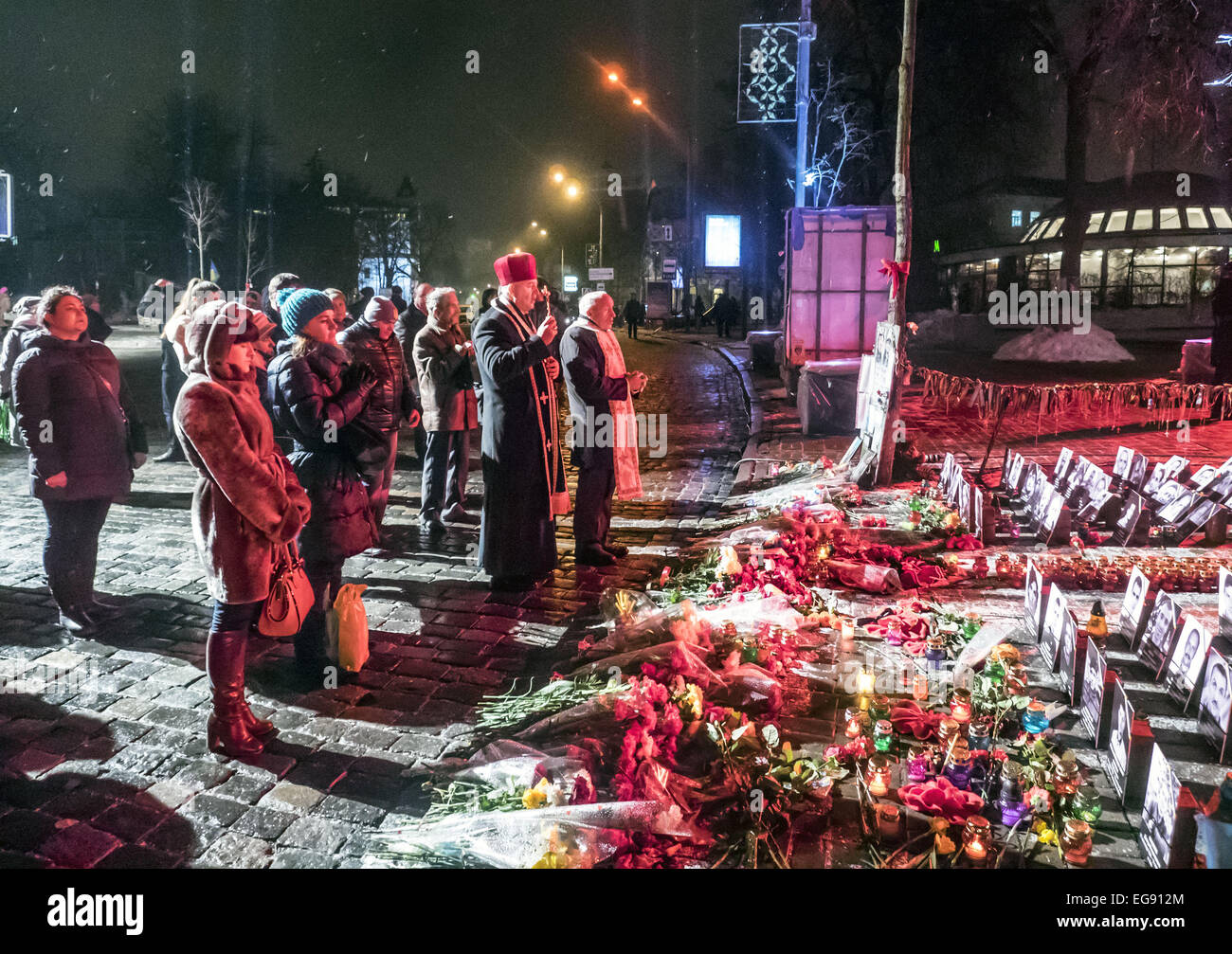 Feb. 19, 2015 - Near the chapel on the street Institutskaya people pray for the dead a year ago during the Ukrainian - Stock Image