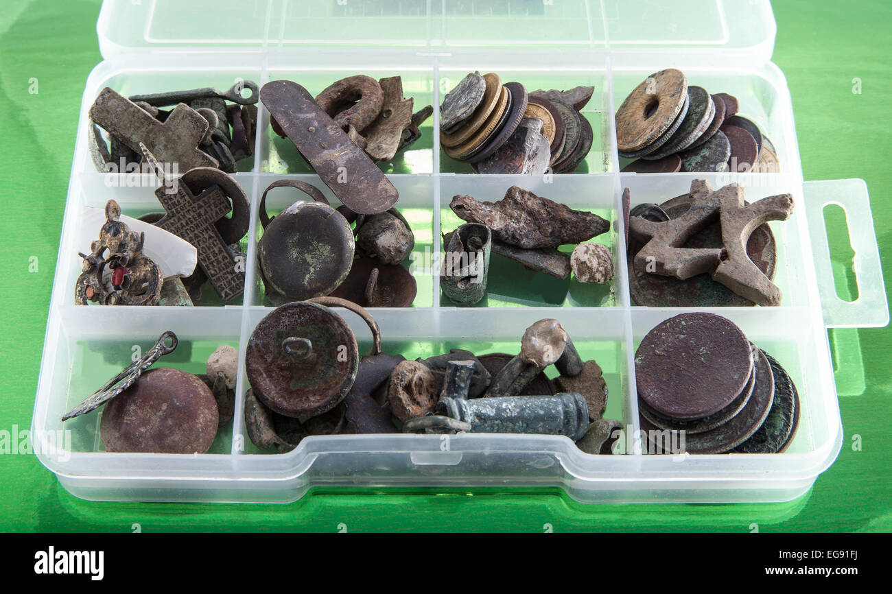 archaeologist finds a box with old metal objects to determine Stock Photo