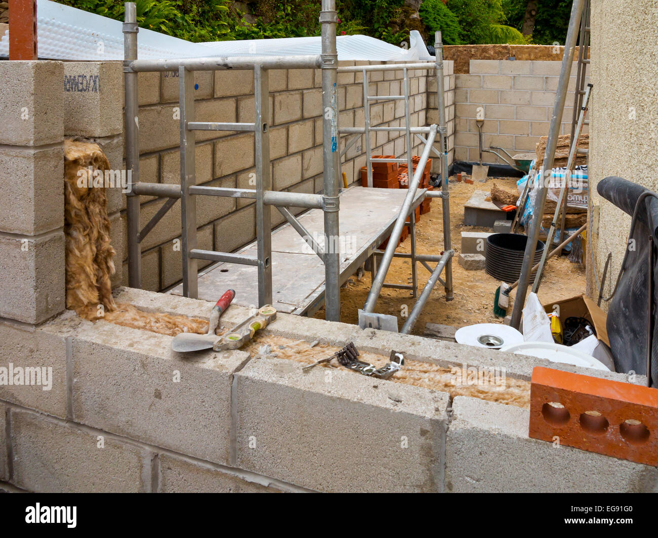 House Extension Under Construction With Insulating Material Visible In  Cavity Between Two Breeze Block Walls To