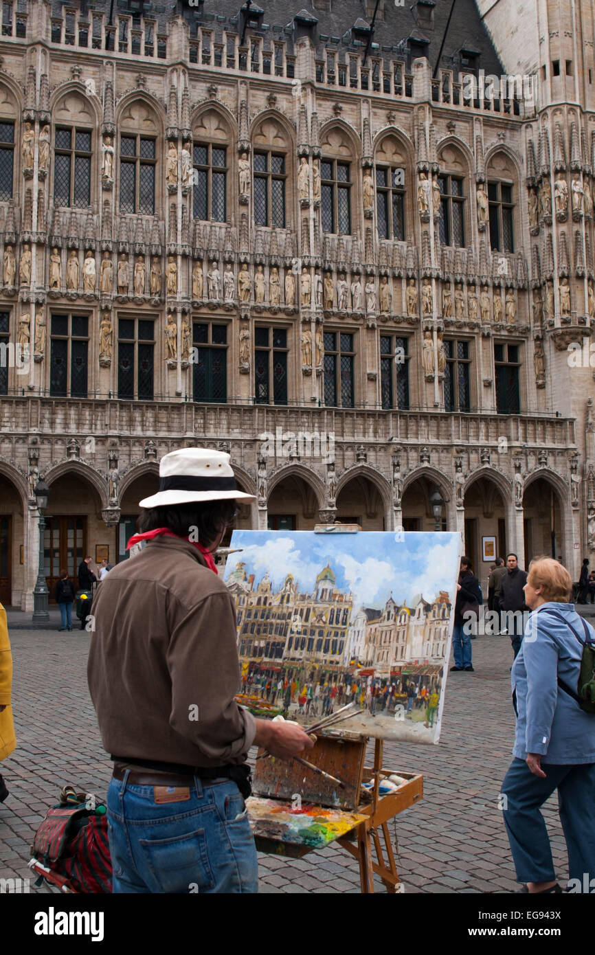 Street artist in Brussels Belgium painting architecture Stock Photo