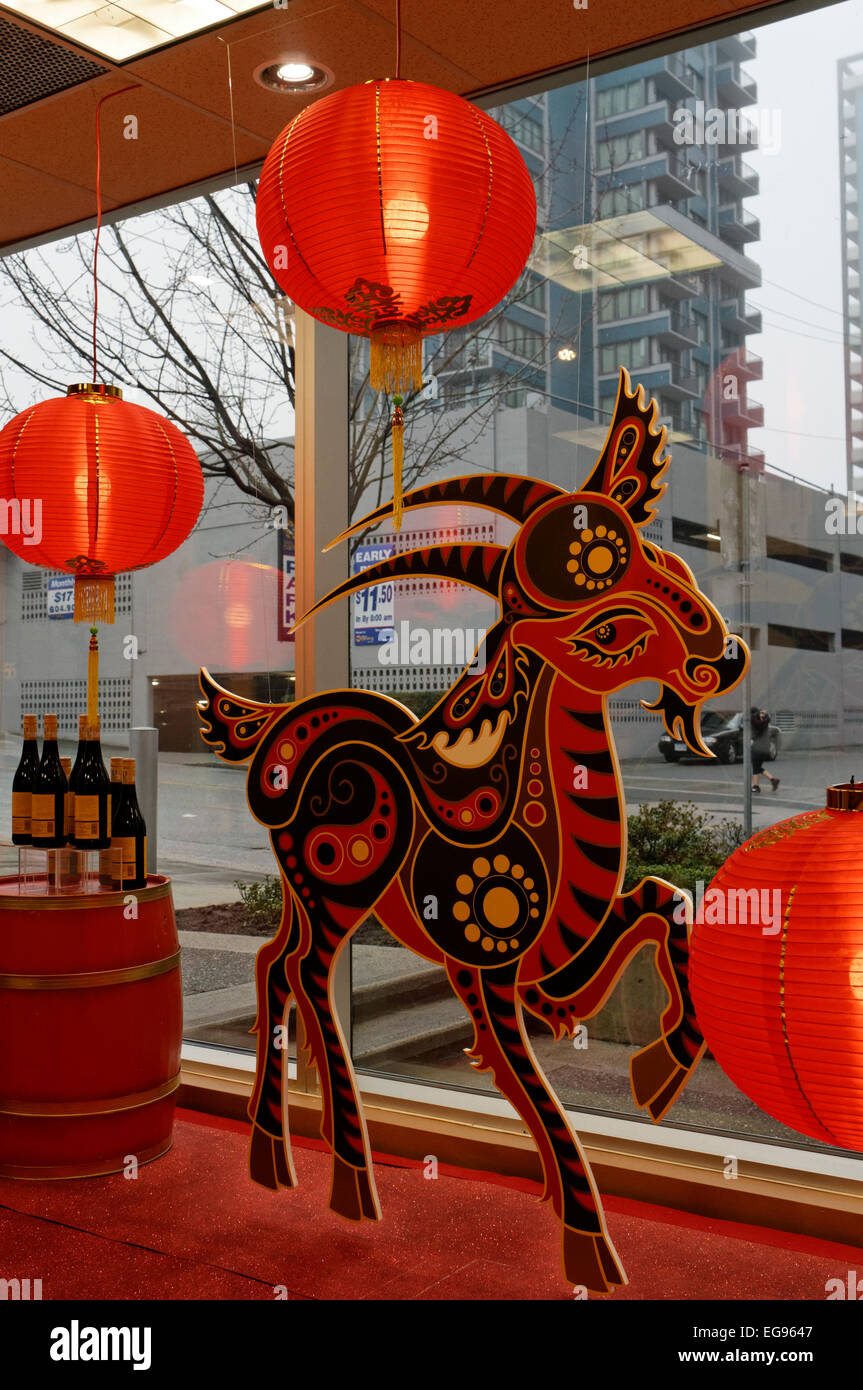 Year of the Goat Chinese New Year 2015 display in a store window, Vancouver, BC,Canada - Stock Image
