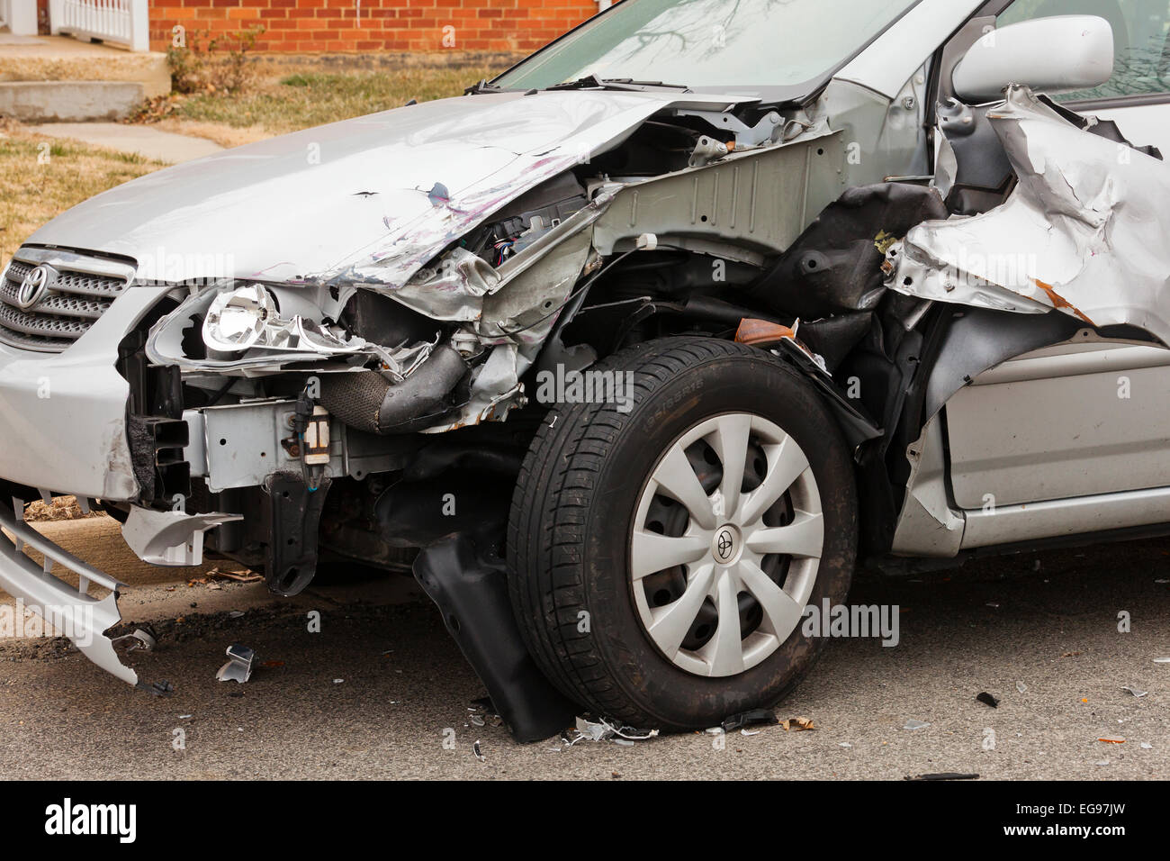 Volkswagen sedan with front end accident damage - USA - Stock Image