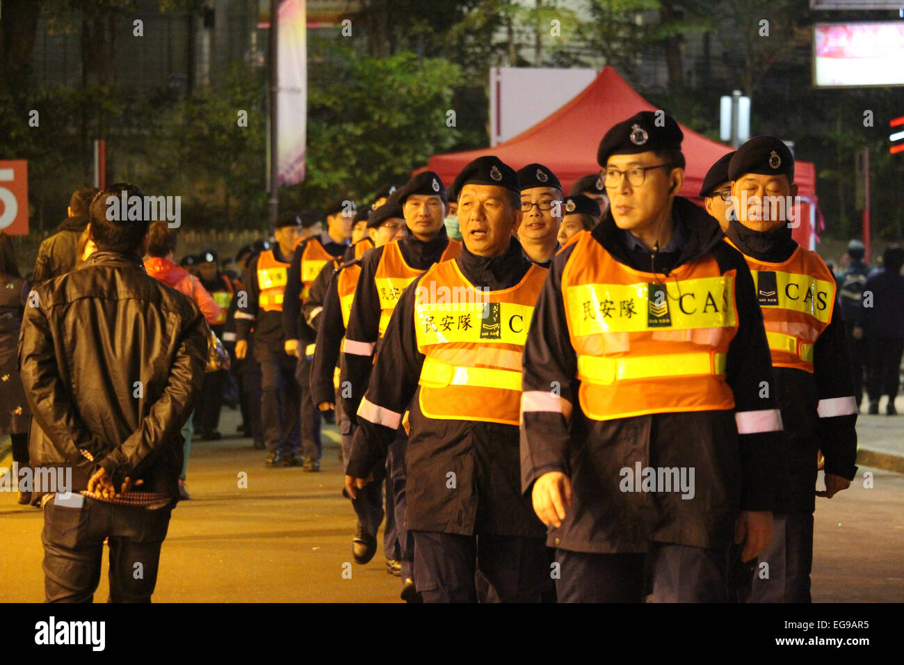 Hong Kong, China. 19th Feb, 2015. Numerous Civil Aid Service (CAS) personnel walk down street during parade in Tsim - Stock Image