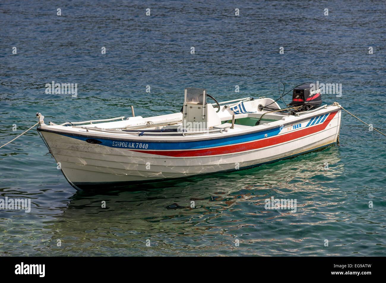 Anchored colorful boat on the sea Corfu island Greece - Stock Image