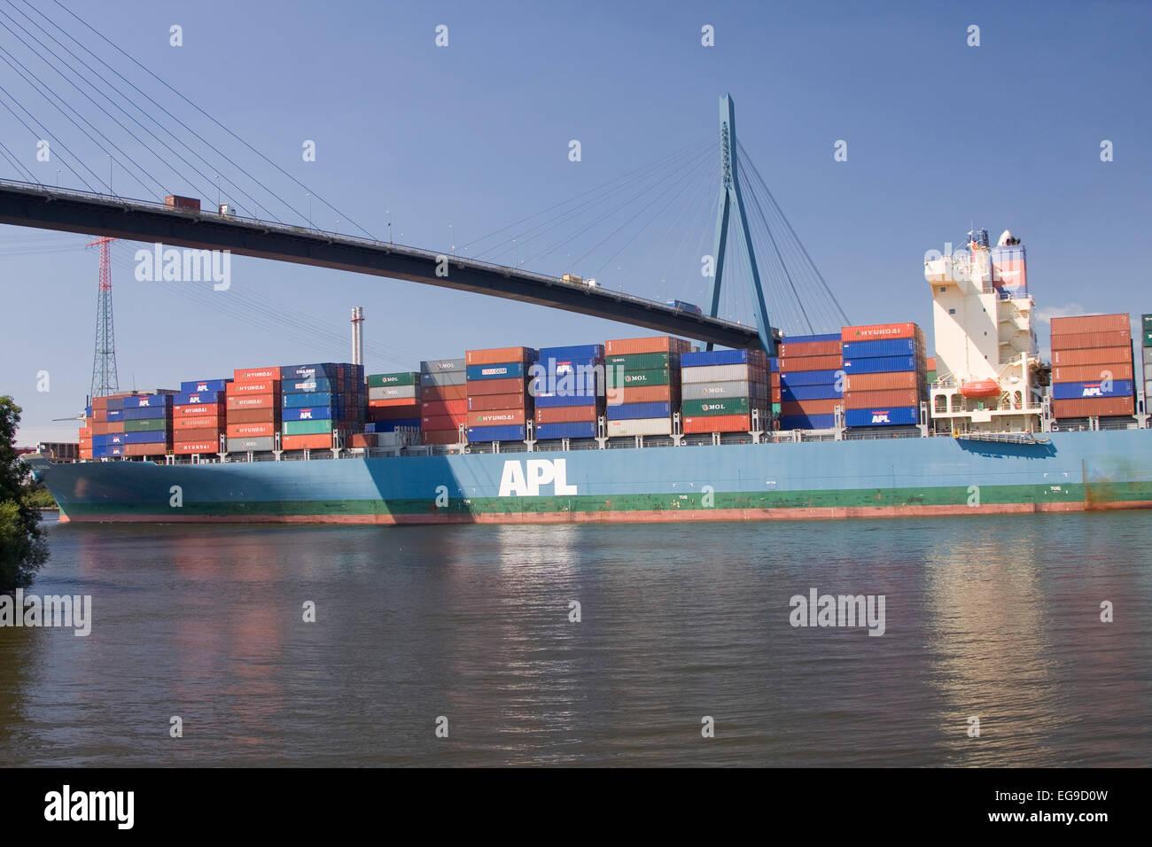 Container ship driving under the Köhlbrand bridge, Hamburg, Germany, Europe Stock Photo