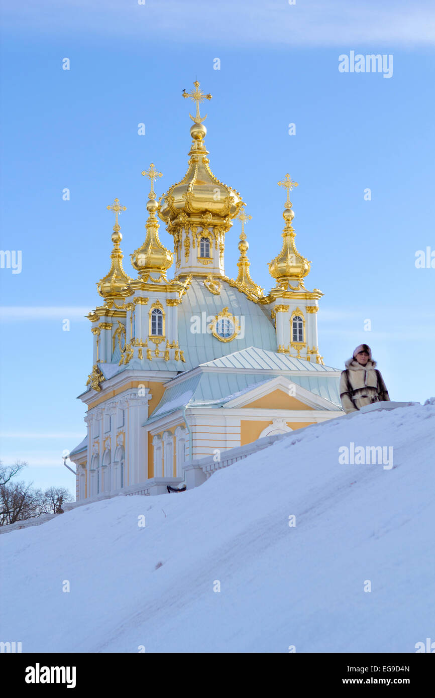 young women near beautiful church in winer. Petergof, St. Petersburg, Russia Stock Photo