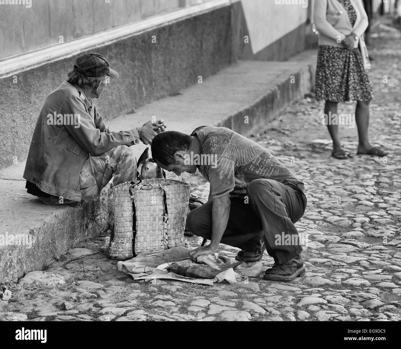 Men selling fresh fish in the streets of Trinidad, Cuba. - Stock Image
