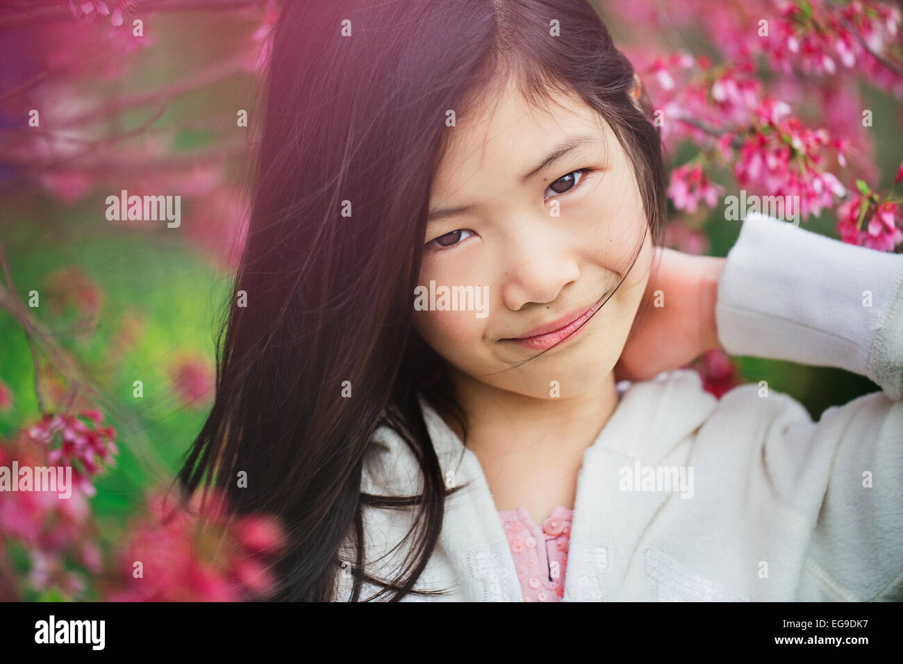 Portrait young girl (8-9) in flowers - Stock Image