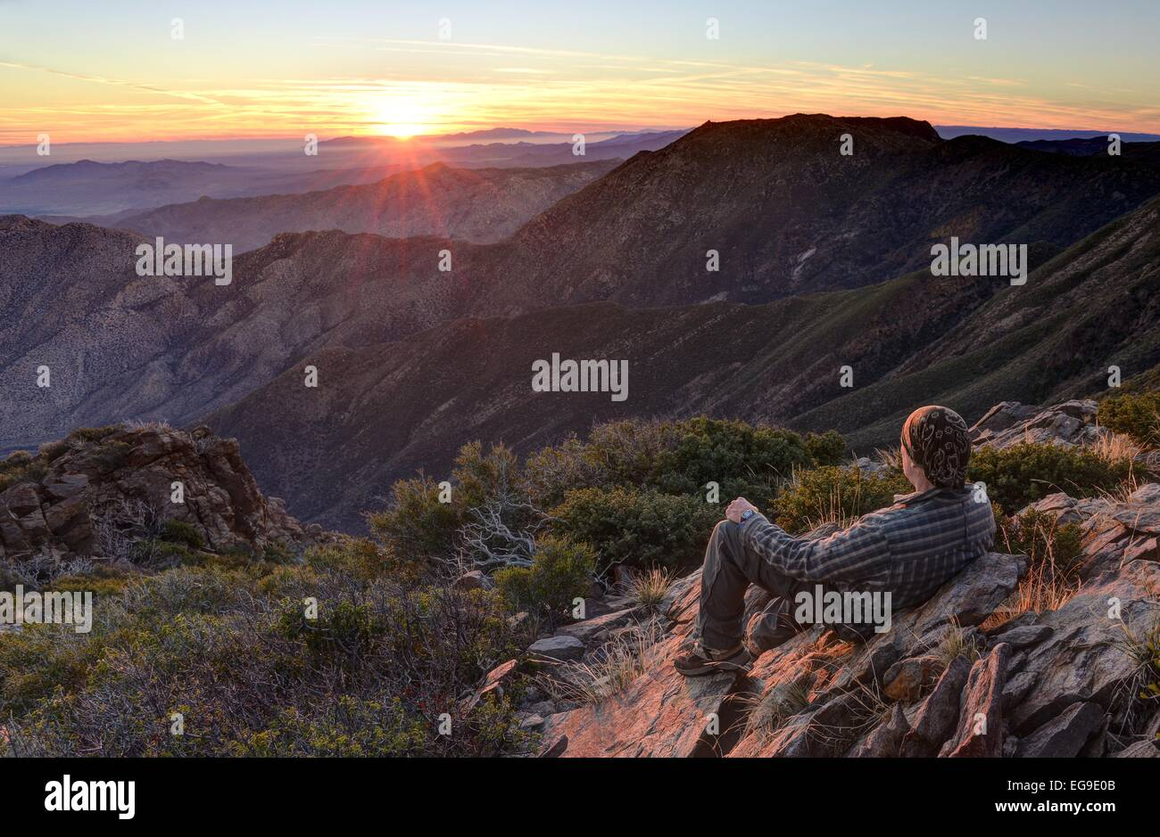 USA, California, Cleveland National Forest, Hiker looking at sunrise - Stock Image