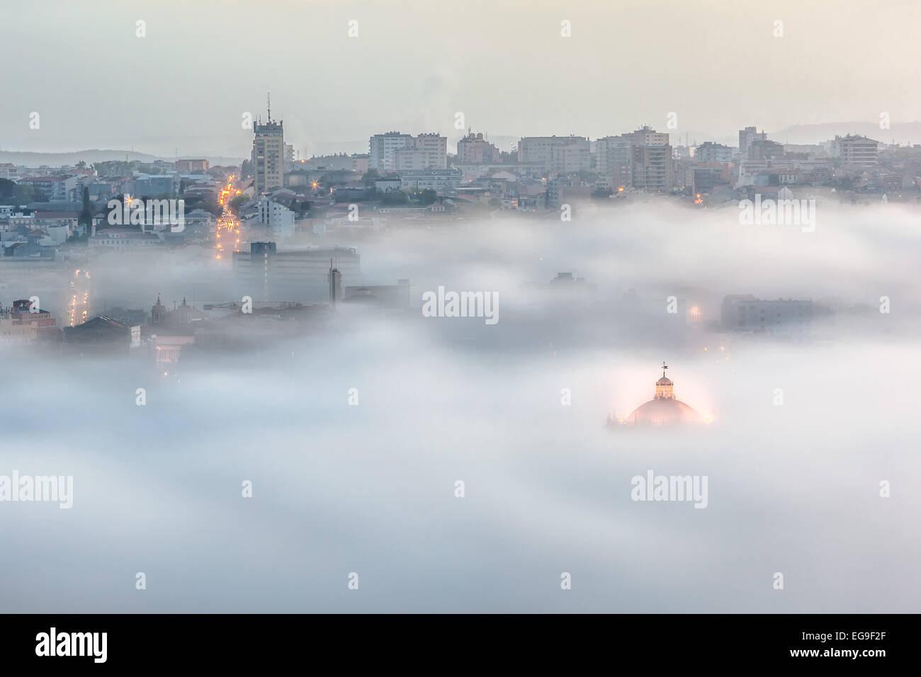 Portugal, Porto, Gaia, Cityscape in fog - Stock Image