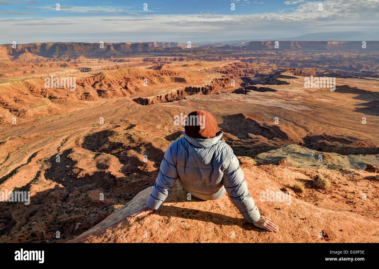 USA, Utah, Canyonlands National Park, Hiker looking at Buck Canyon - Stock Image