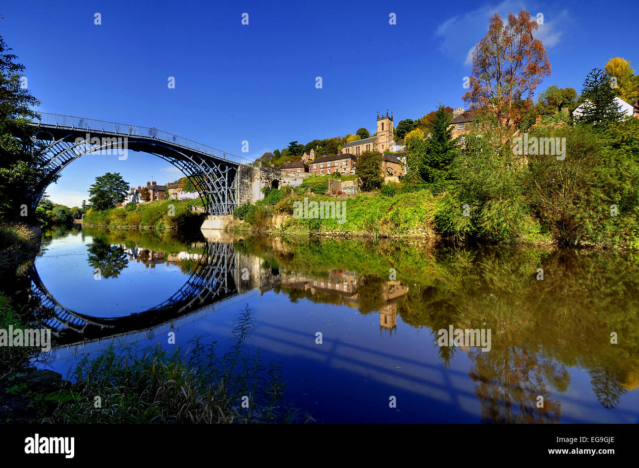 UK, England, Shropshire, Telford, Symmetrical view of Ironbridge and hill reflecting in water - Stock Image
