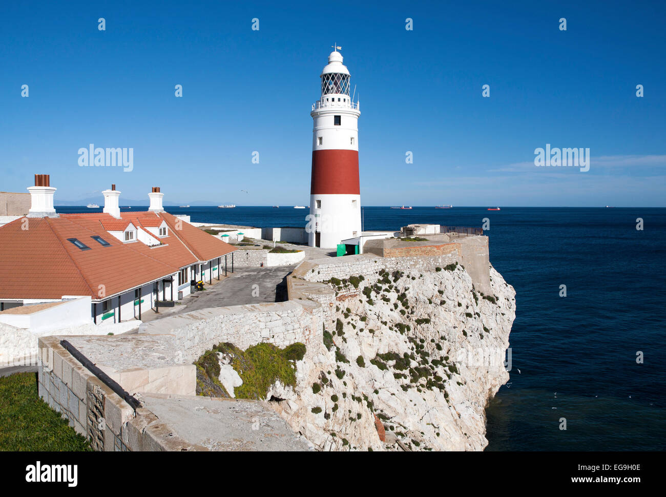 Red and white striped lighthouse at Europa Point, Gibraltar, British territory in southern Europe - Stock Image