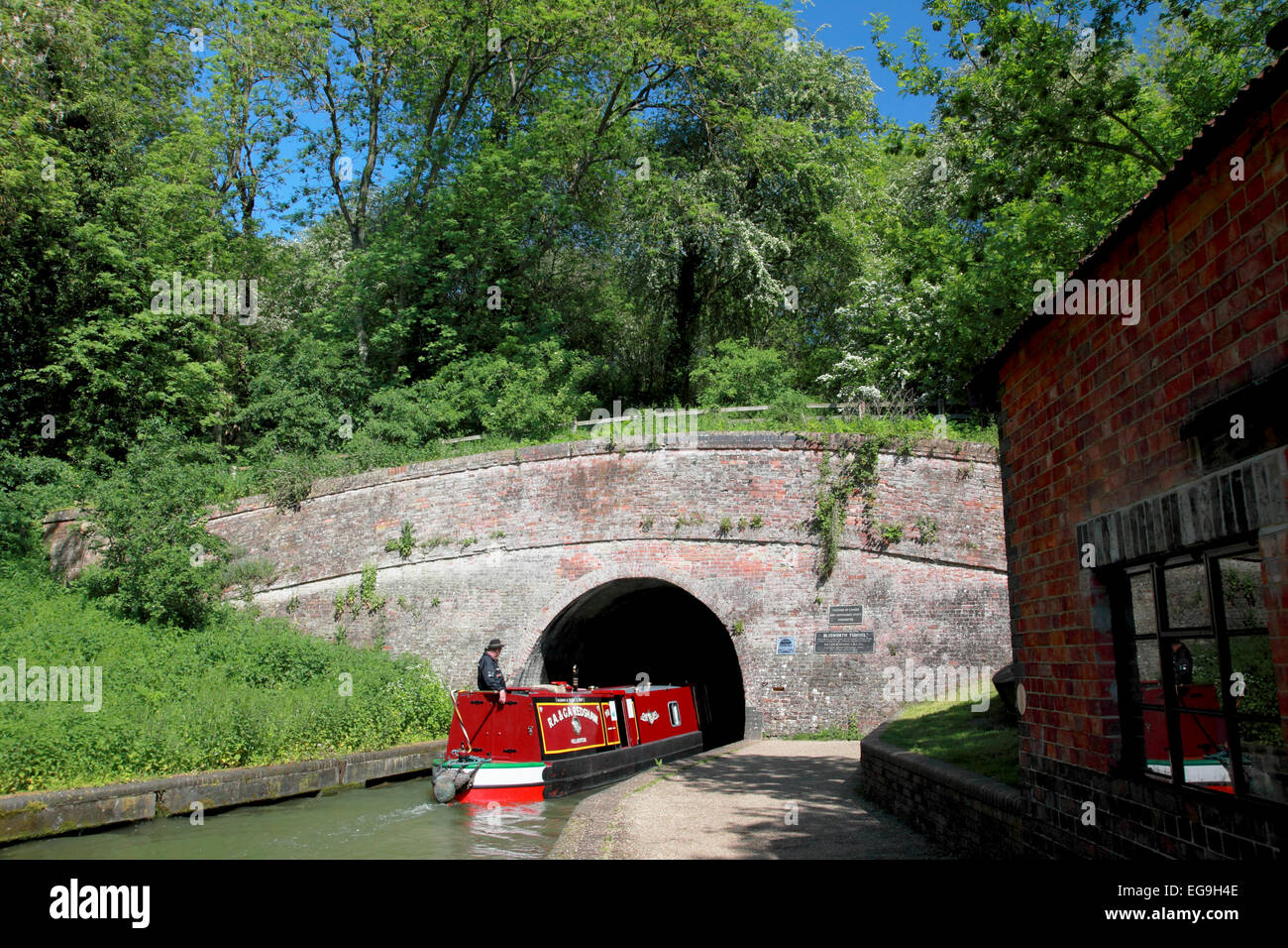 A narrowboat entering the southern portal of Blisworth Tunnel on the Grand Union Canal at Stoke Bruerne, Northamptonshire - Stock Image