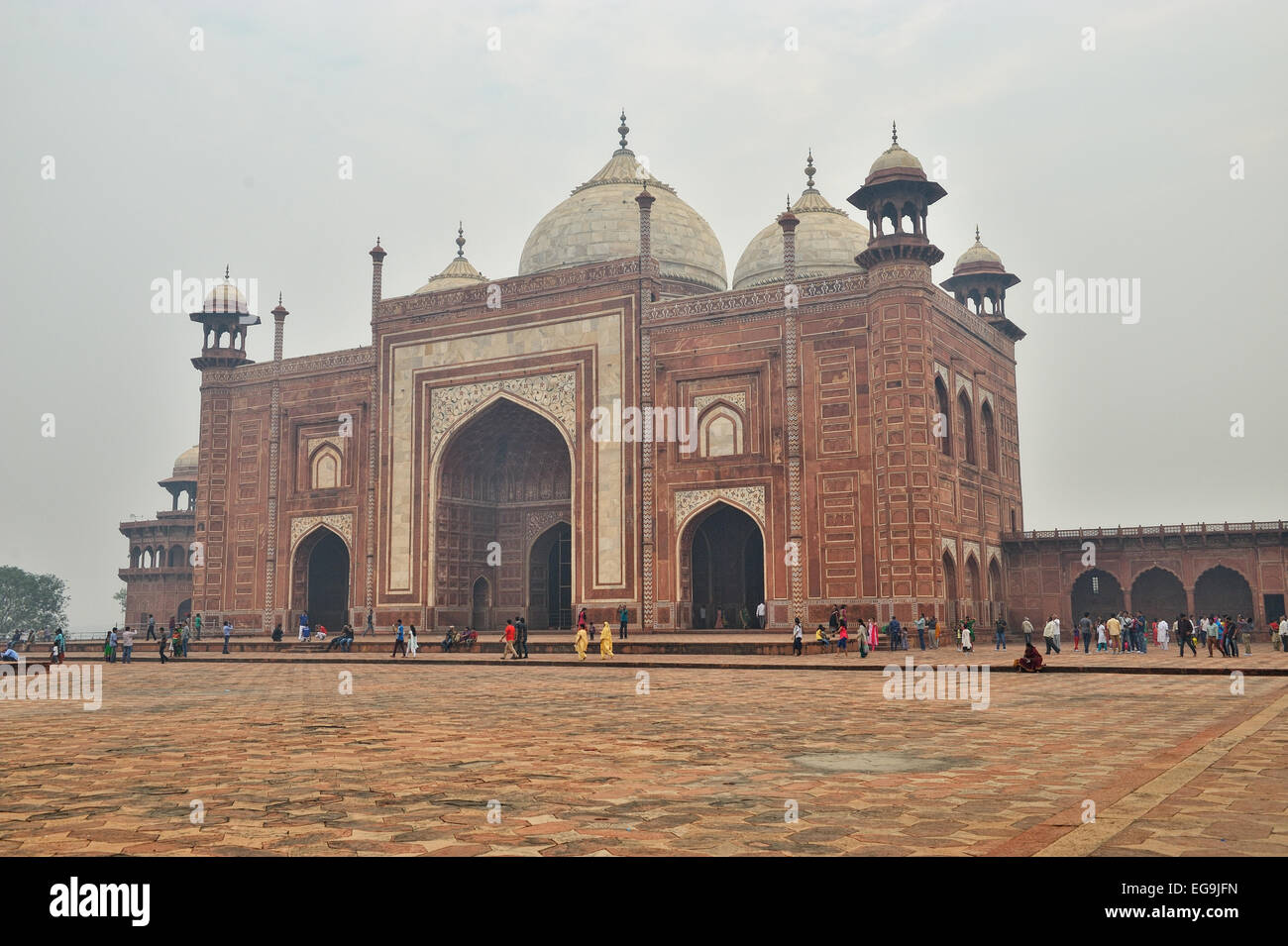 At the far end of the complex, there are two grand red sandstone buildings that face the sides of the tomb - Stock Image