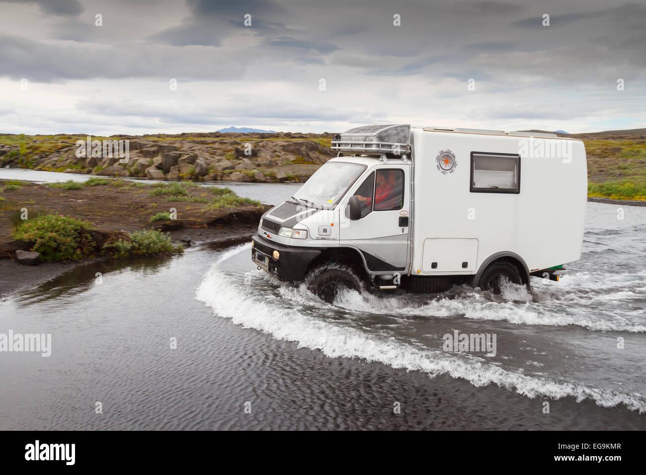 Van fording a river. Askja caldera route. Central Highlands. Iceland, Europe. - Stock Image