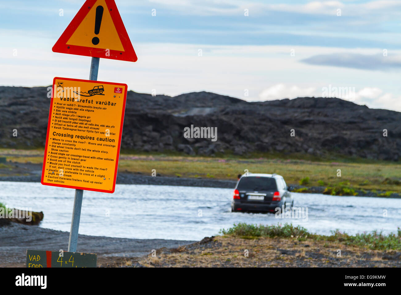 four-wheel car fording a river. Askja caldera route. Central Highlands. Iceland, Europe. - Stock Image